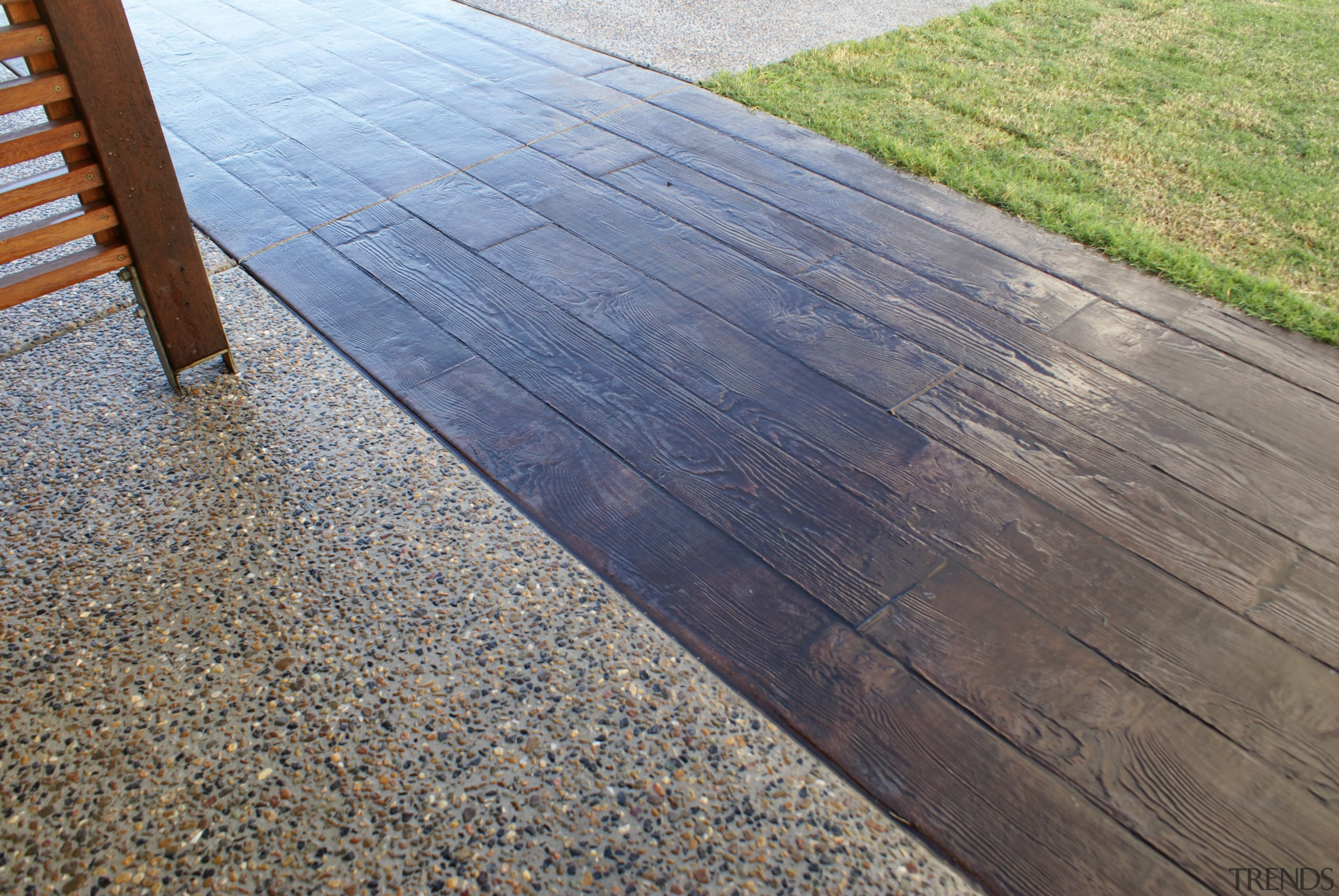 Wood boards? No, this is a concrete surface deck, floor, flooring, hardwood, line, road surface, walkway, wood, wood stain, gray