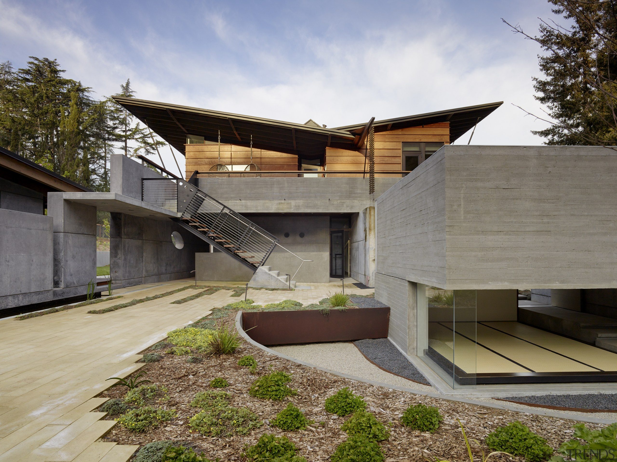​​​​​​​The butterfly roof design on this home conceals architecture, , home, house, residential, cladding, concrete, redwood, FuTung Cheng, Cheng Design
