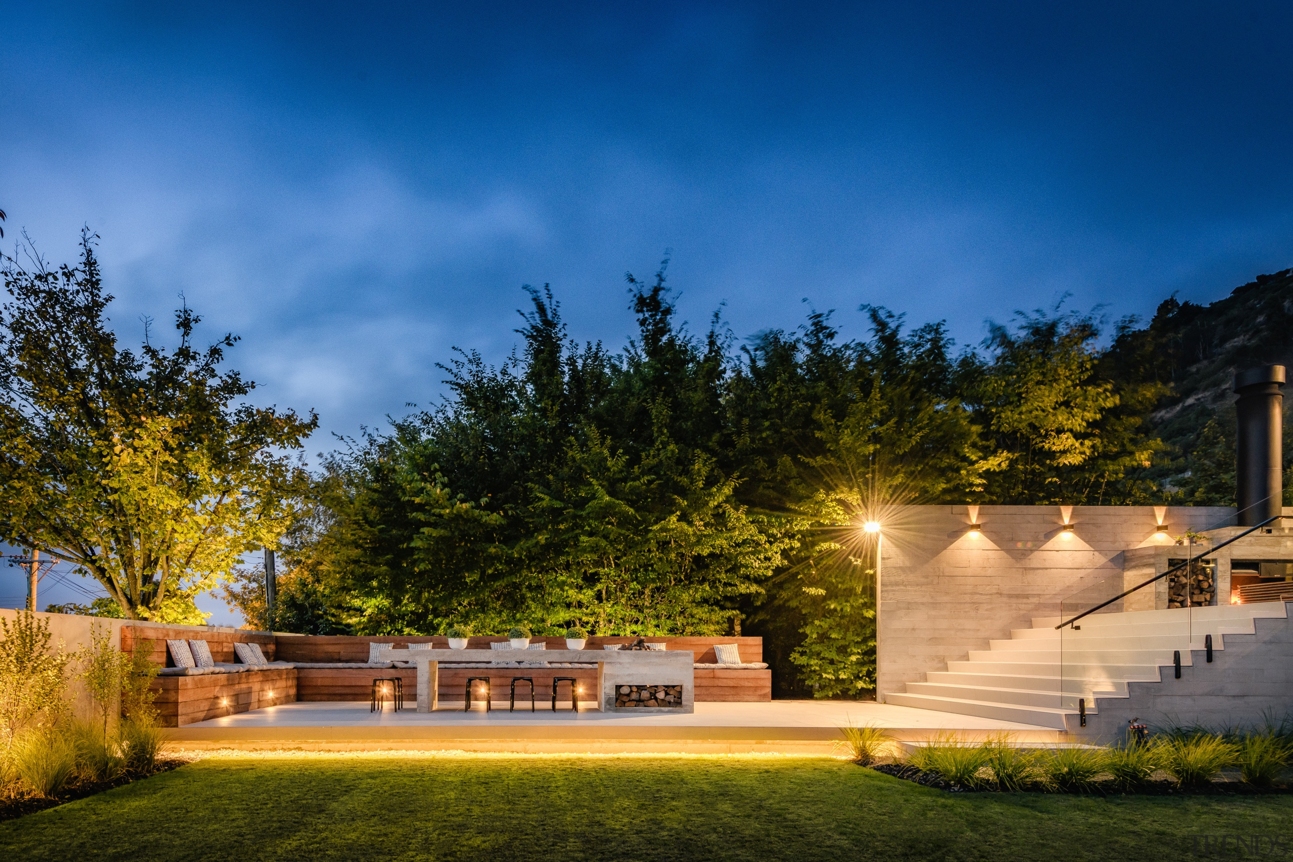 This home by designers Marcus Freeman and Hayden architecture, building, cloud, estate, facade, grass, home, house, land lot, landscape, landscape lighting, landscaping, light, lighting, night, property, real estate, residential area, sky, tree, yard, brown