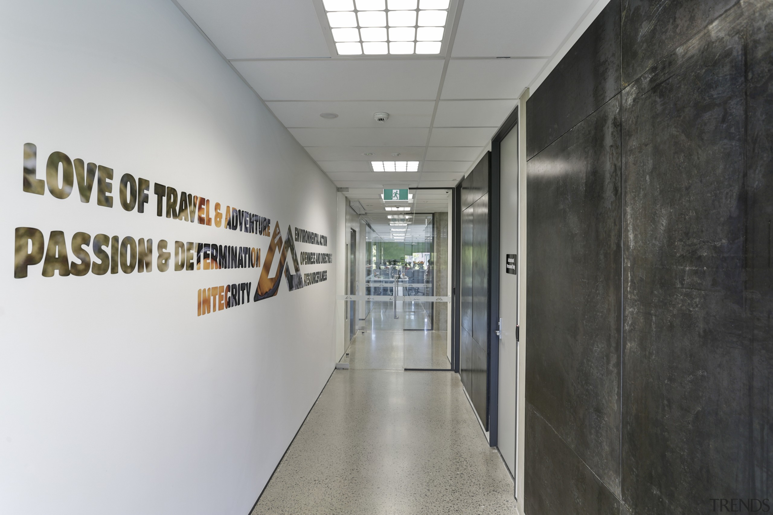 Waxed steel walls and empowering slogans feature in gray, black
