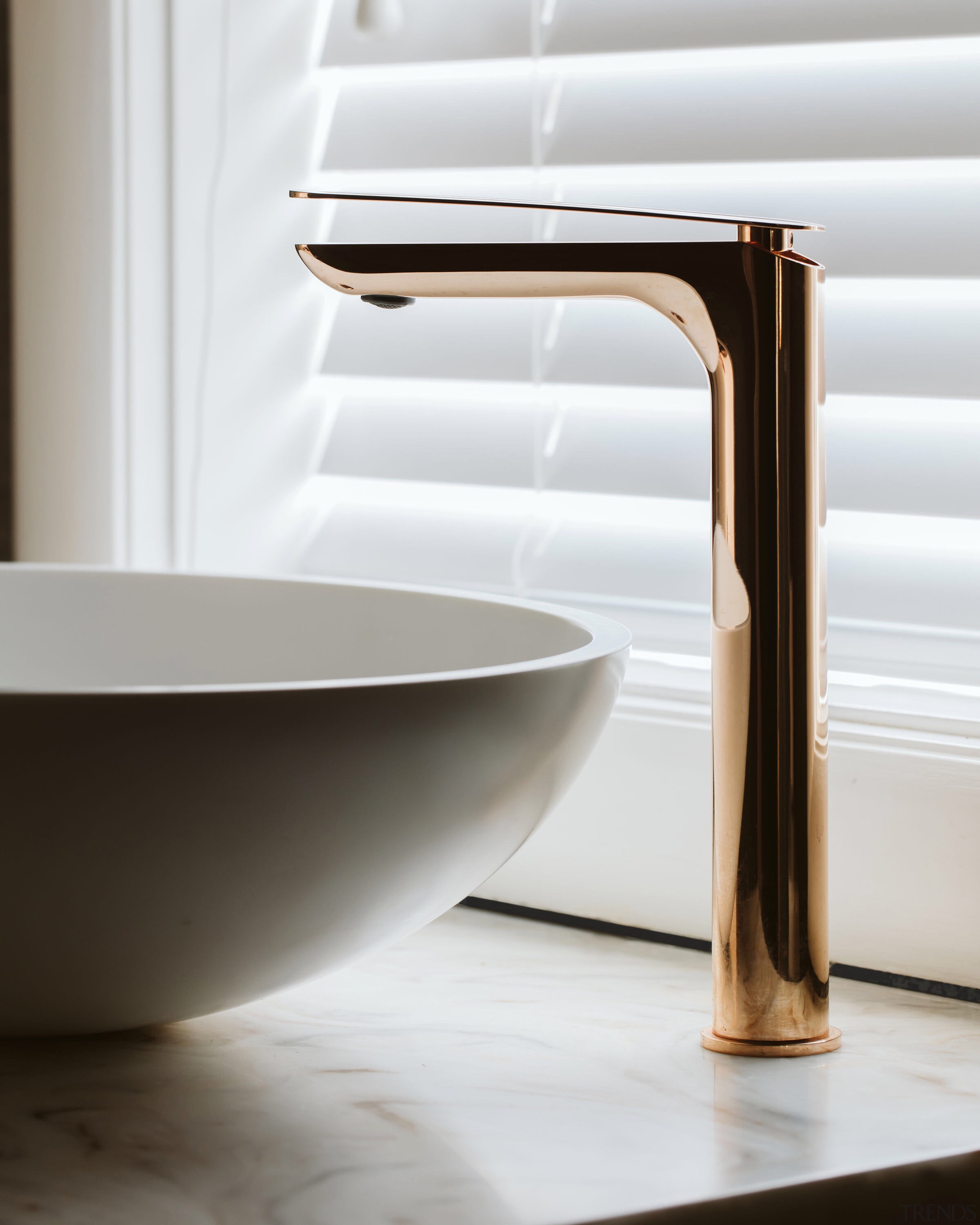 The allure of rose gold fittings adds to white, gray