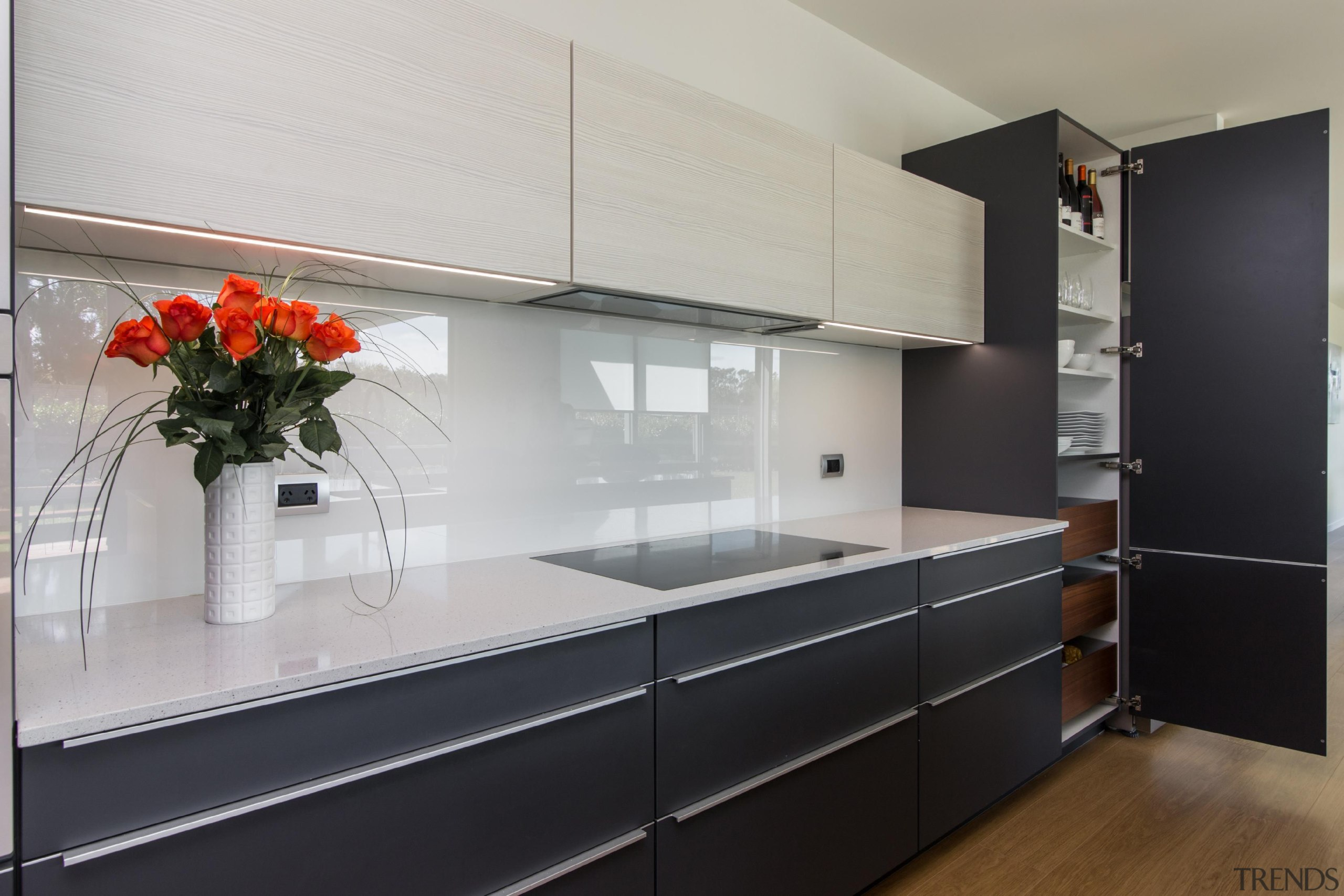 Great use of space for kitchen storageFor more cabinetry, countertop, interior design, kitchen, gray, black