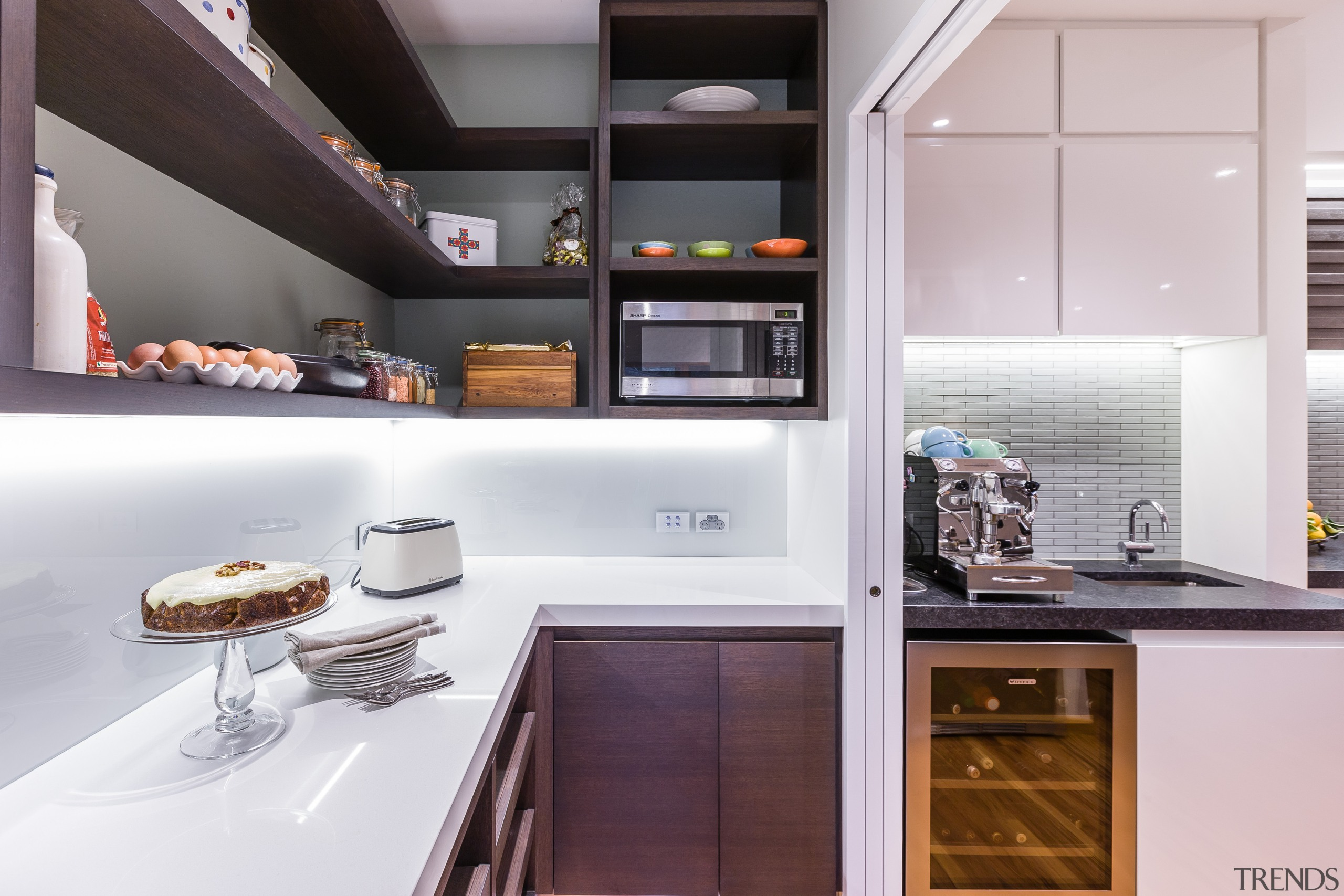 Handle-free cabinetry adds to the minimalist look of countertop, cuisine classique, home appliance, interior design, kitchen, white