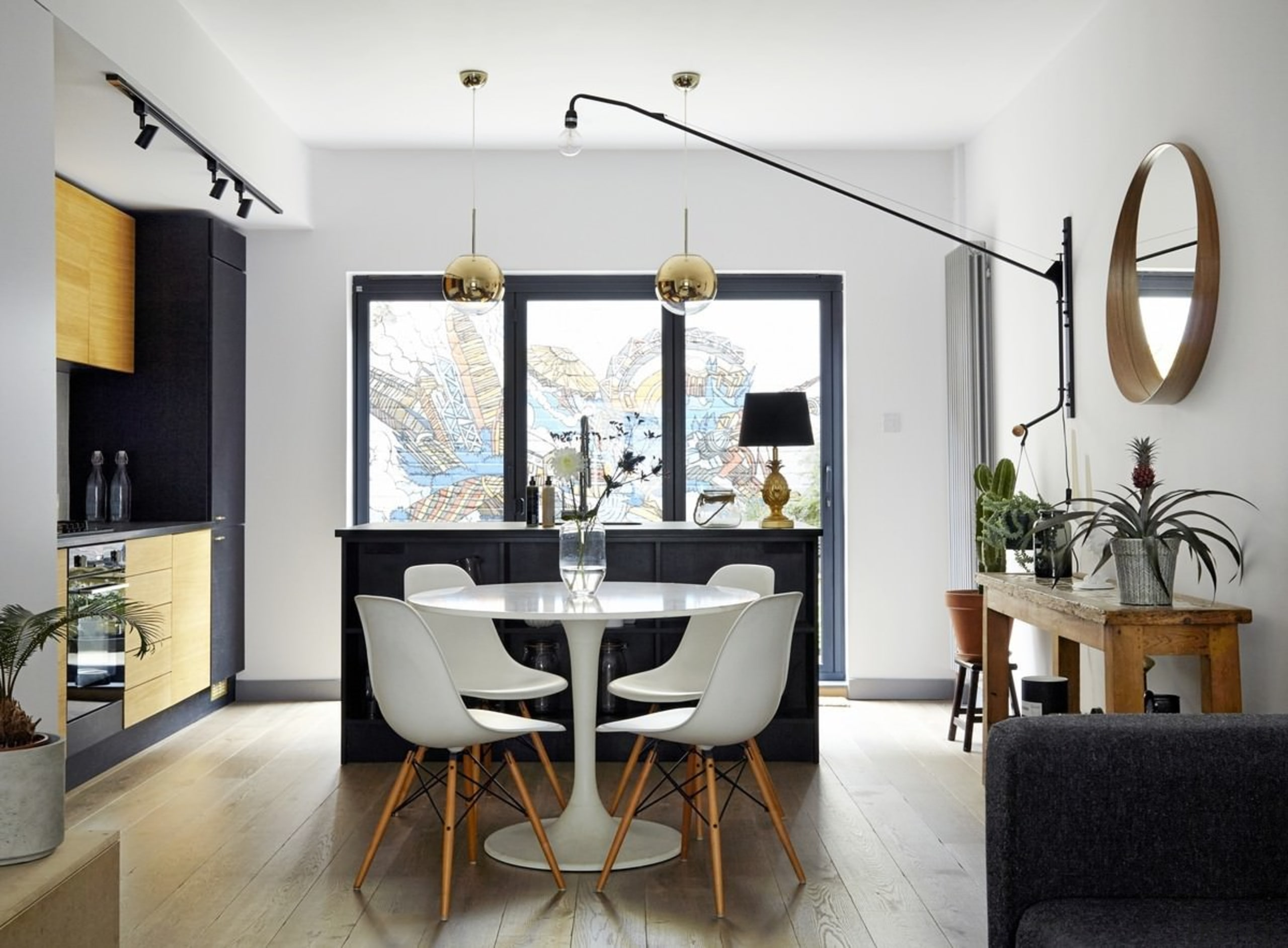 The kitchen/dining area is cozy and close to ceiling, chair, dining room, furniture, home, interior design, living room, room, table, white