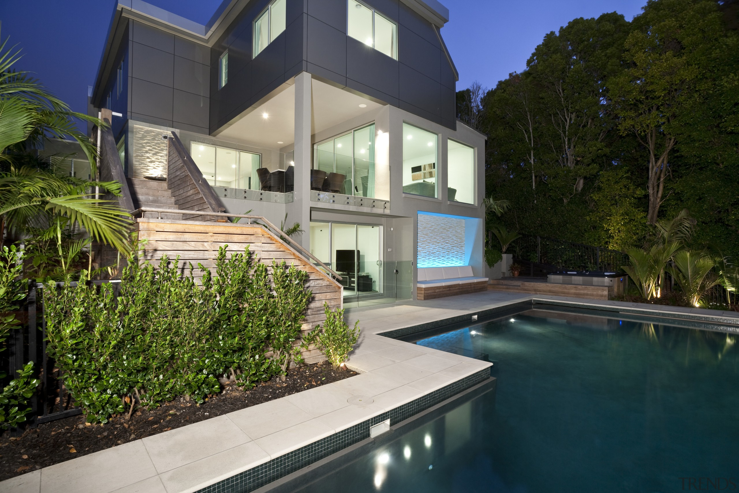 View of sleek poolscape with textured stone wall, architecture, backyard, estate, facade, home, house, property, real estate, residential area, resort, swimming pool, villa