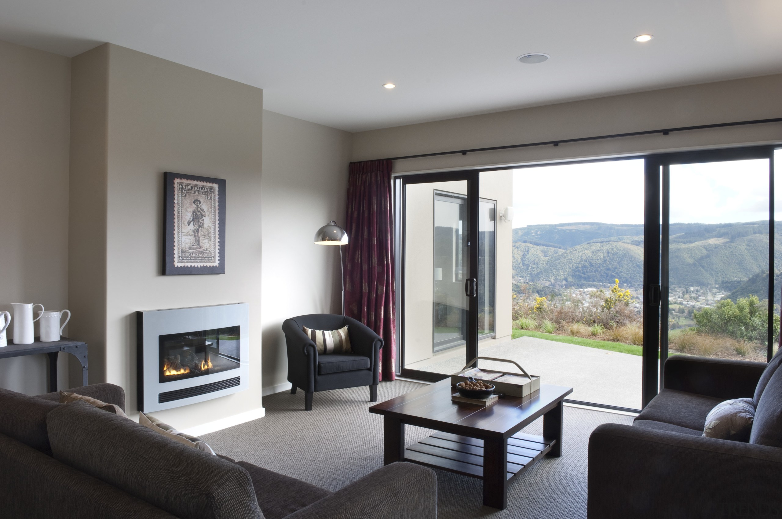 This Upper Hutt Show home was designed and interior design, living room, property, real estate, room, window, gray