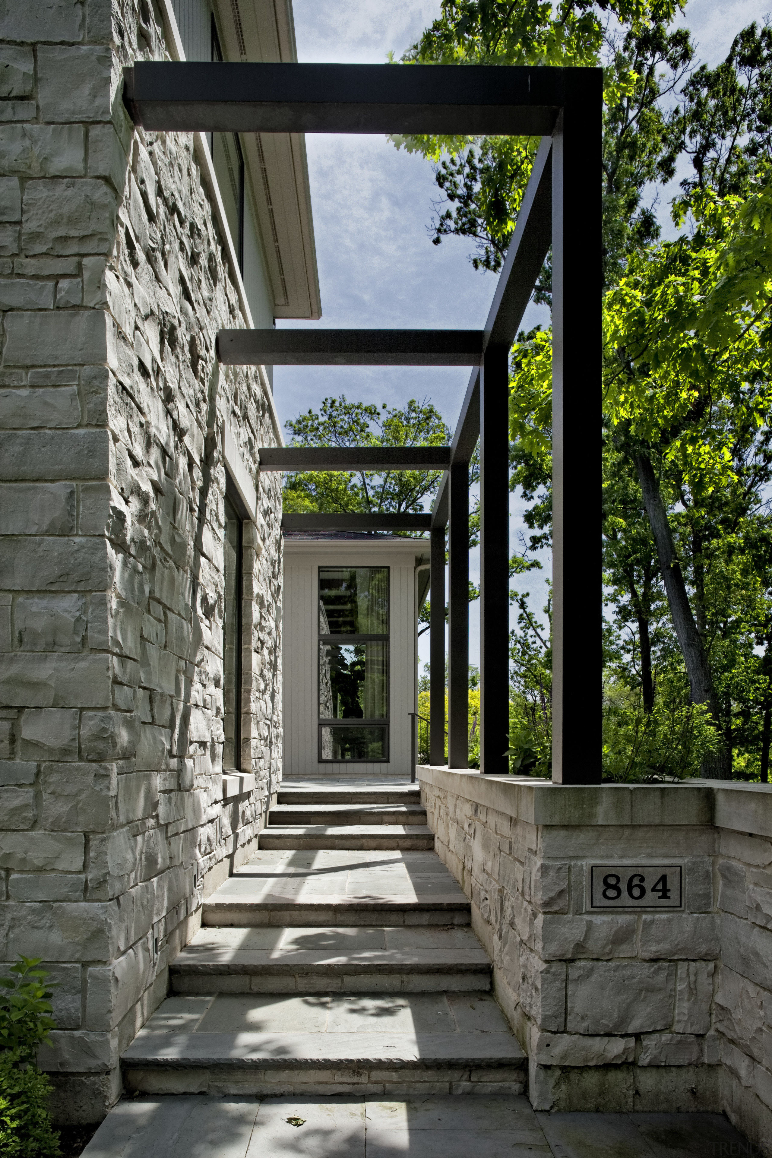 stone outside with paved stairs leading to door architecture, estate, house, outdoor structure, residential area, structure, walkway, black, gray