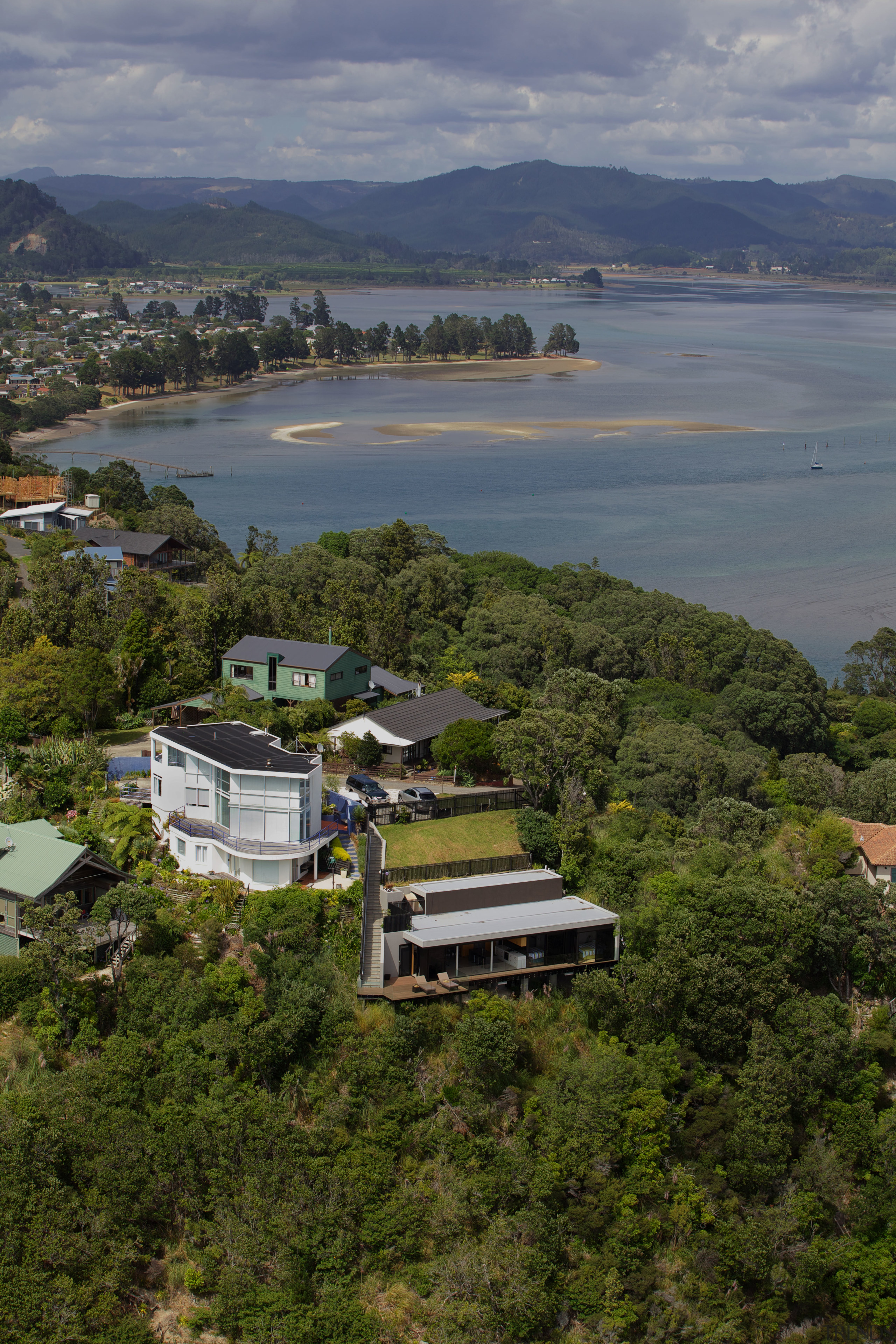 Hidden from the street above, the holiday home aerial photography, bay, bird's eye view, city, cloud, coast, highland, hill, hill station, house, lake, landscape, loch, mountain, real estate, reservoir, river, sea, sky, suburb, tree, water, brown, gray