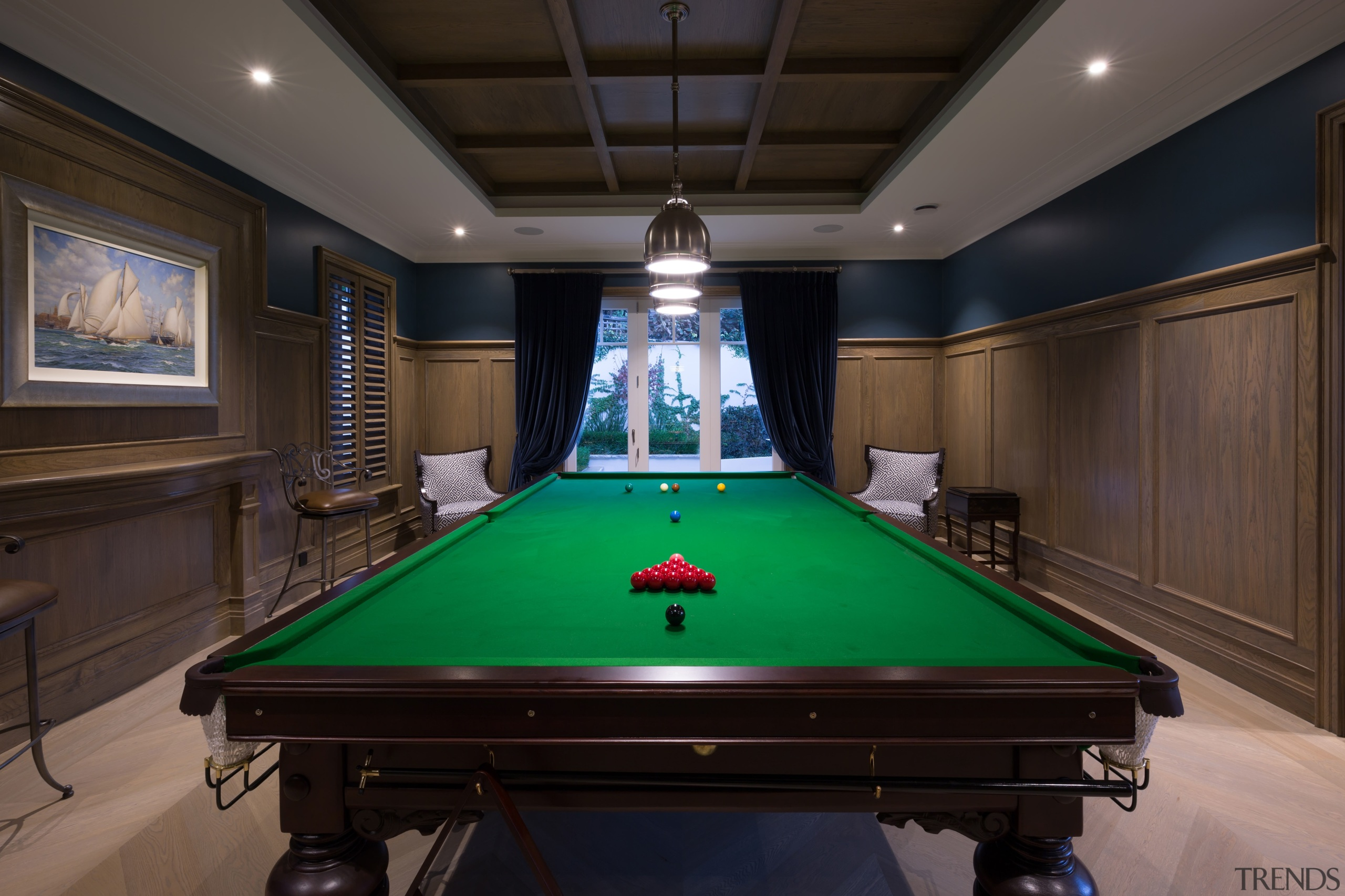 Ornate panelling seen on the ceiling and walls billiard room, billiard table, blackball pool, carom billiards, cue sports, english billiards, games, indoor games and sports, pocket billiards, pool, recreation room, room, snooker, table, black