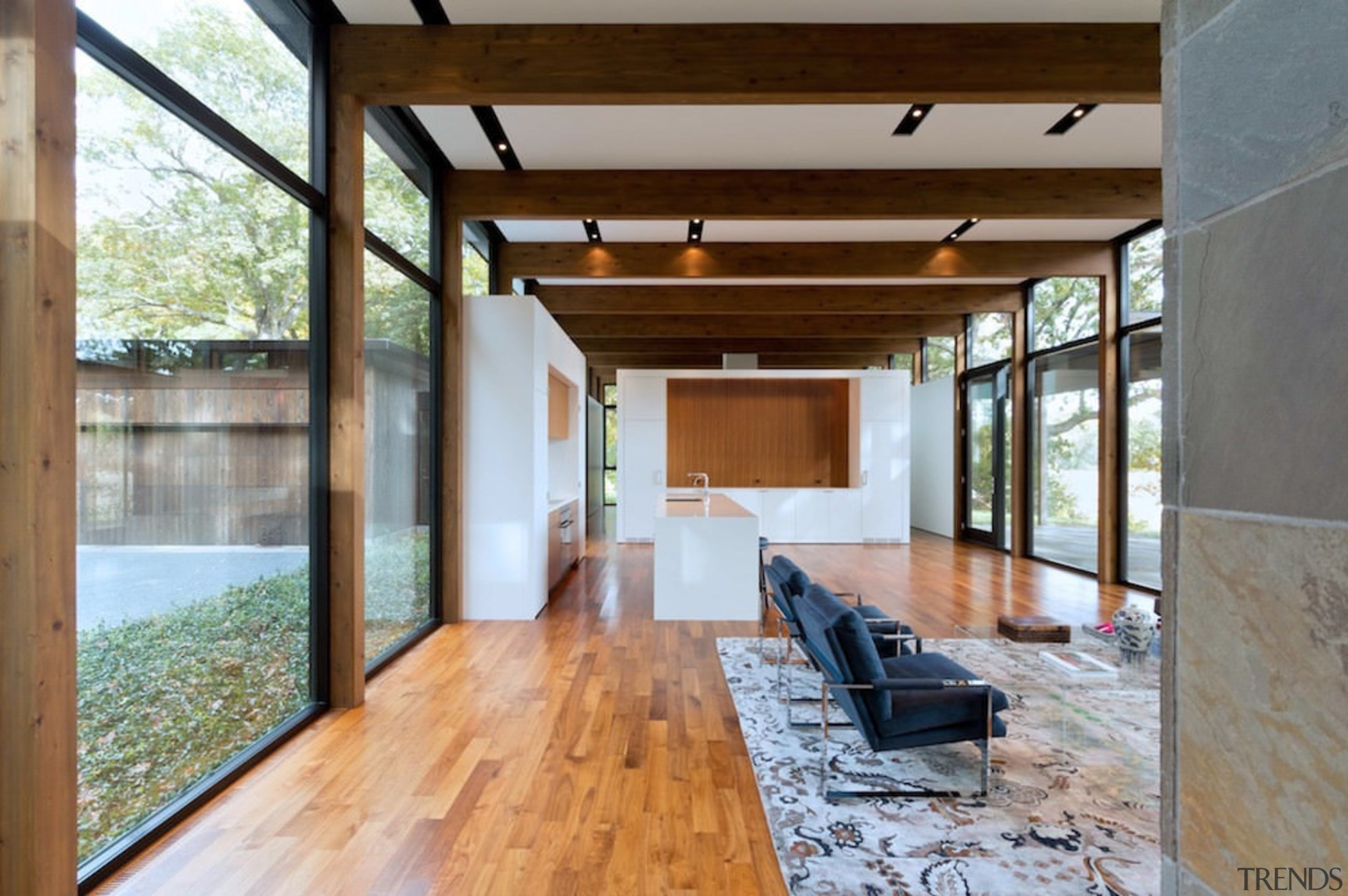 The living areas are spacious and open, featuring architecture, daylighting, estate, floor, flooring, hardwood, home, house, interior design, living room, real estate, window, wood, wood flooring, gray, brown