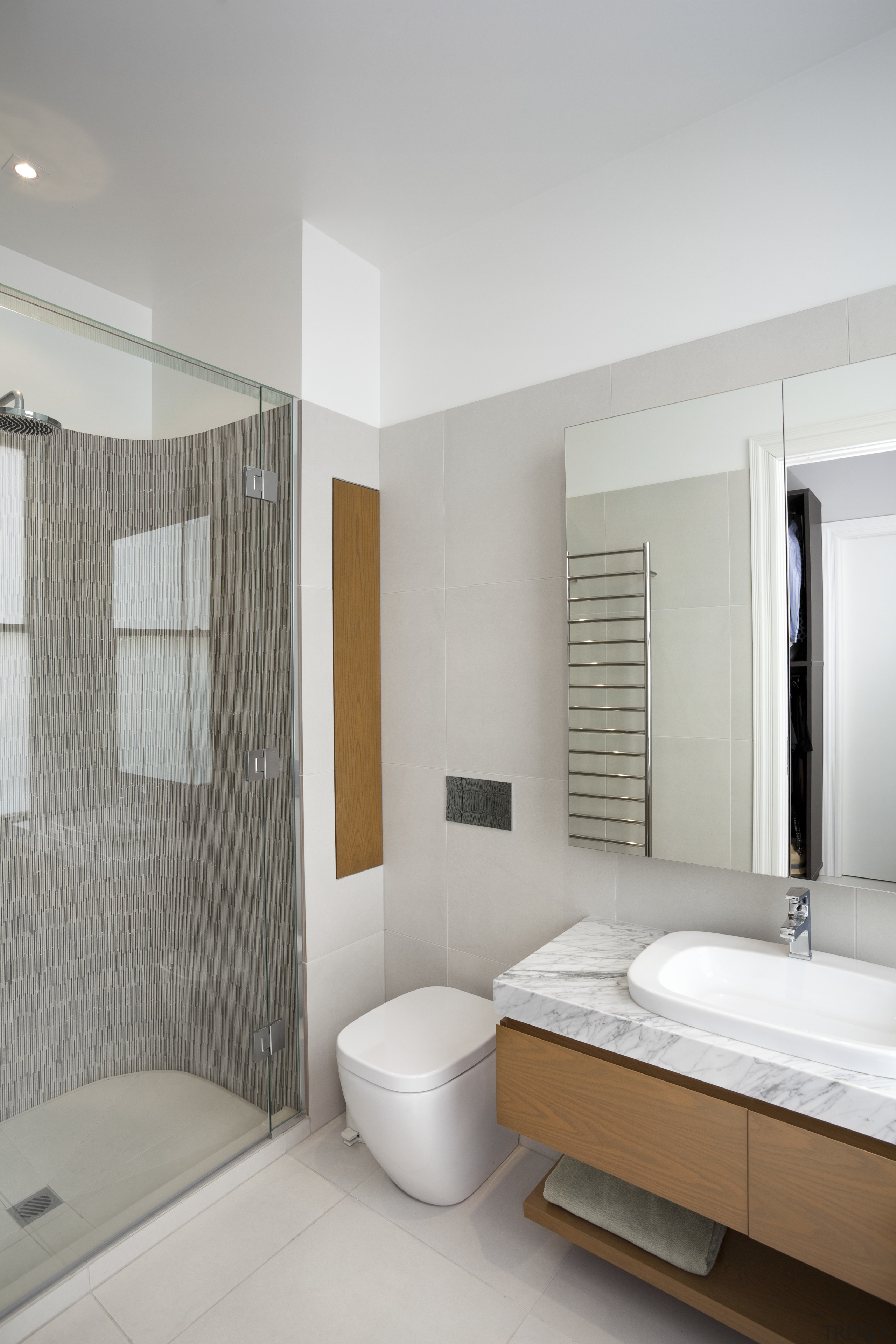 Although small, this master ensuite bathroom is well equipped with contemporary fixtures and fittings. The marble vanity top is the same material that is ...