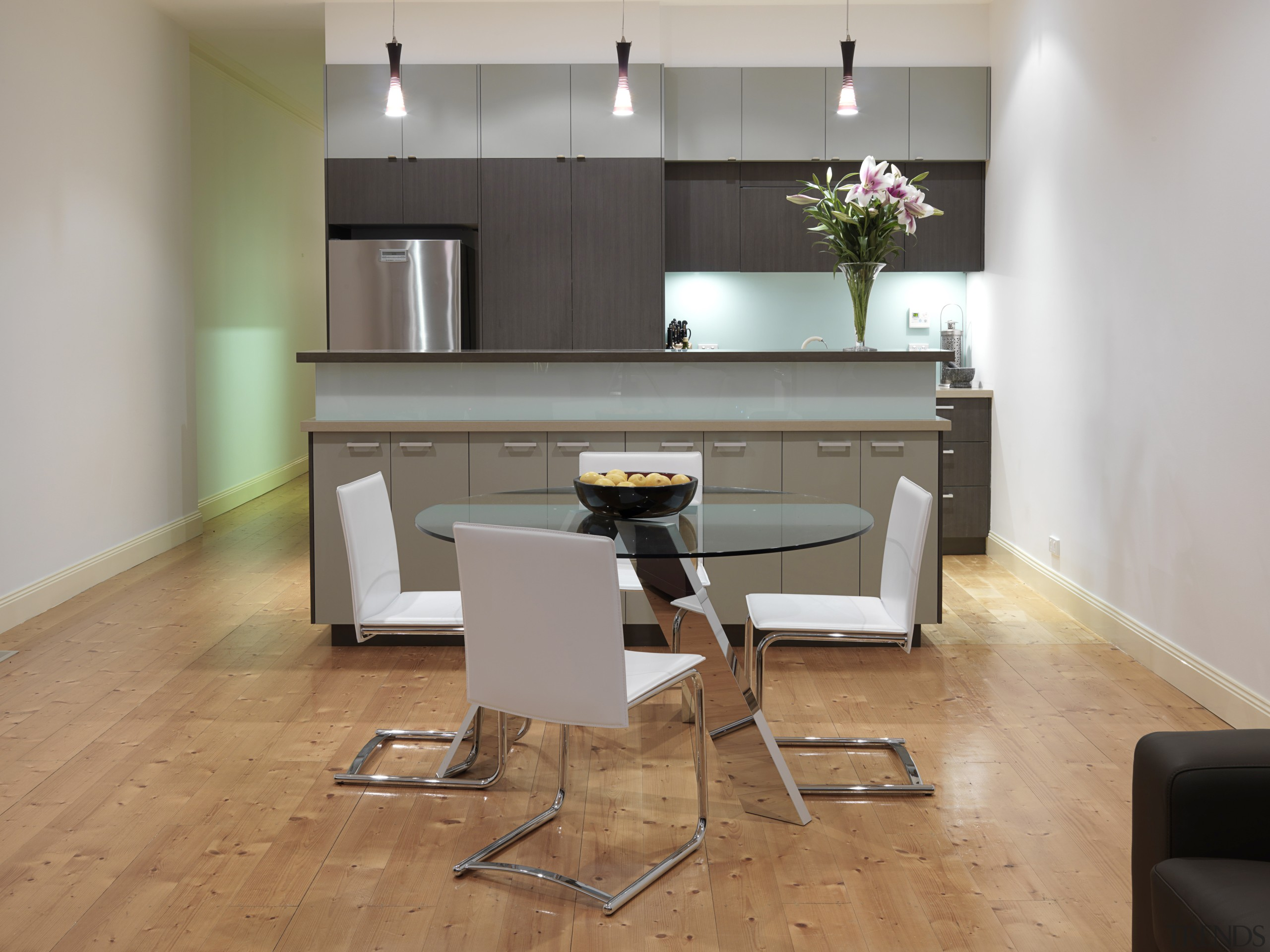 View of minimal kitchen and dining area featuring chair, desk, floor, flooring, furniture, hardwood, interior design, room, table, wood, wood flooring, gray