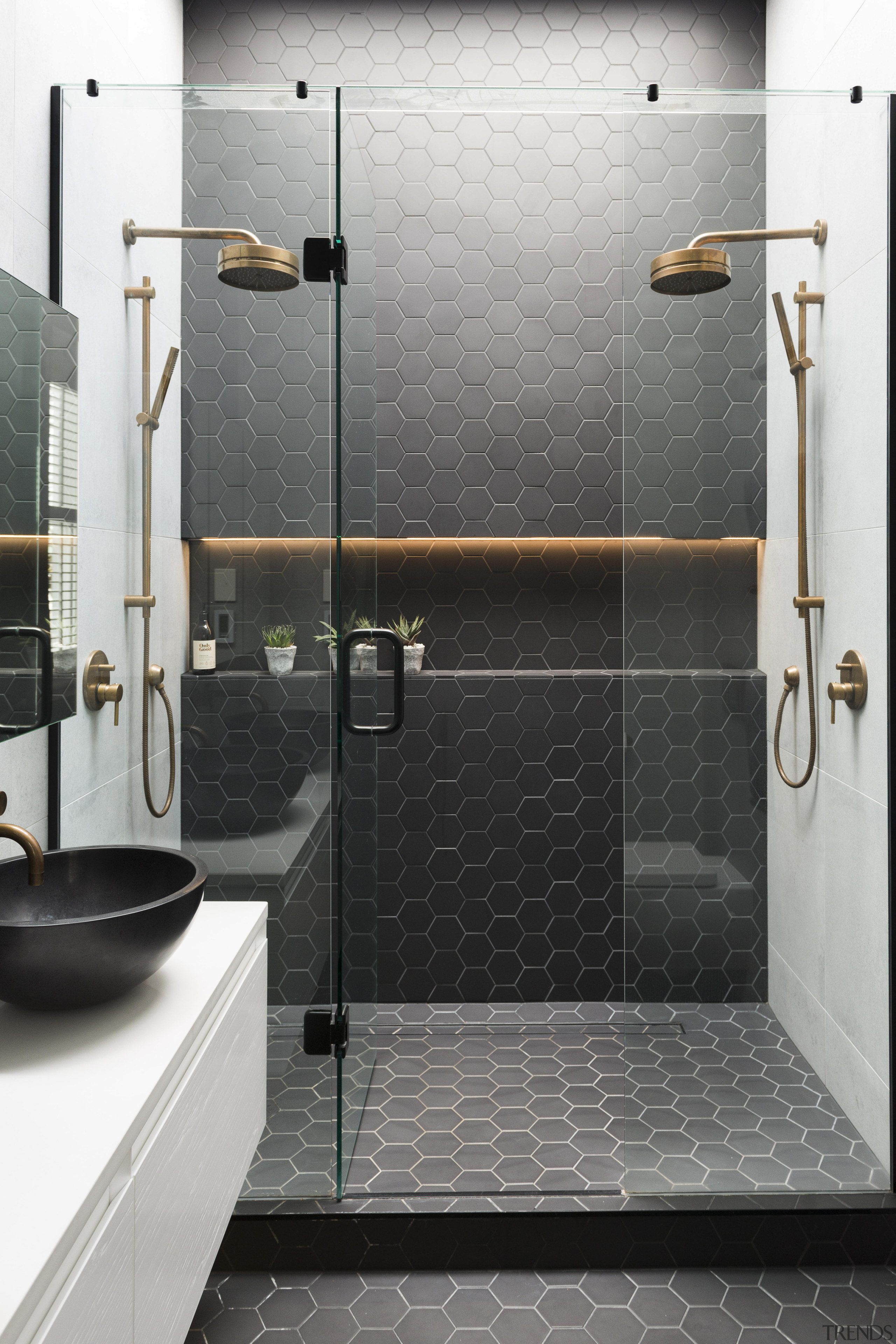 Black meets white with touches of warm brass bathroom, floor, flooring, plumbing fixture, room, shower, tile, wall, gray, black, white