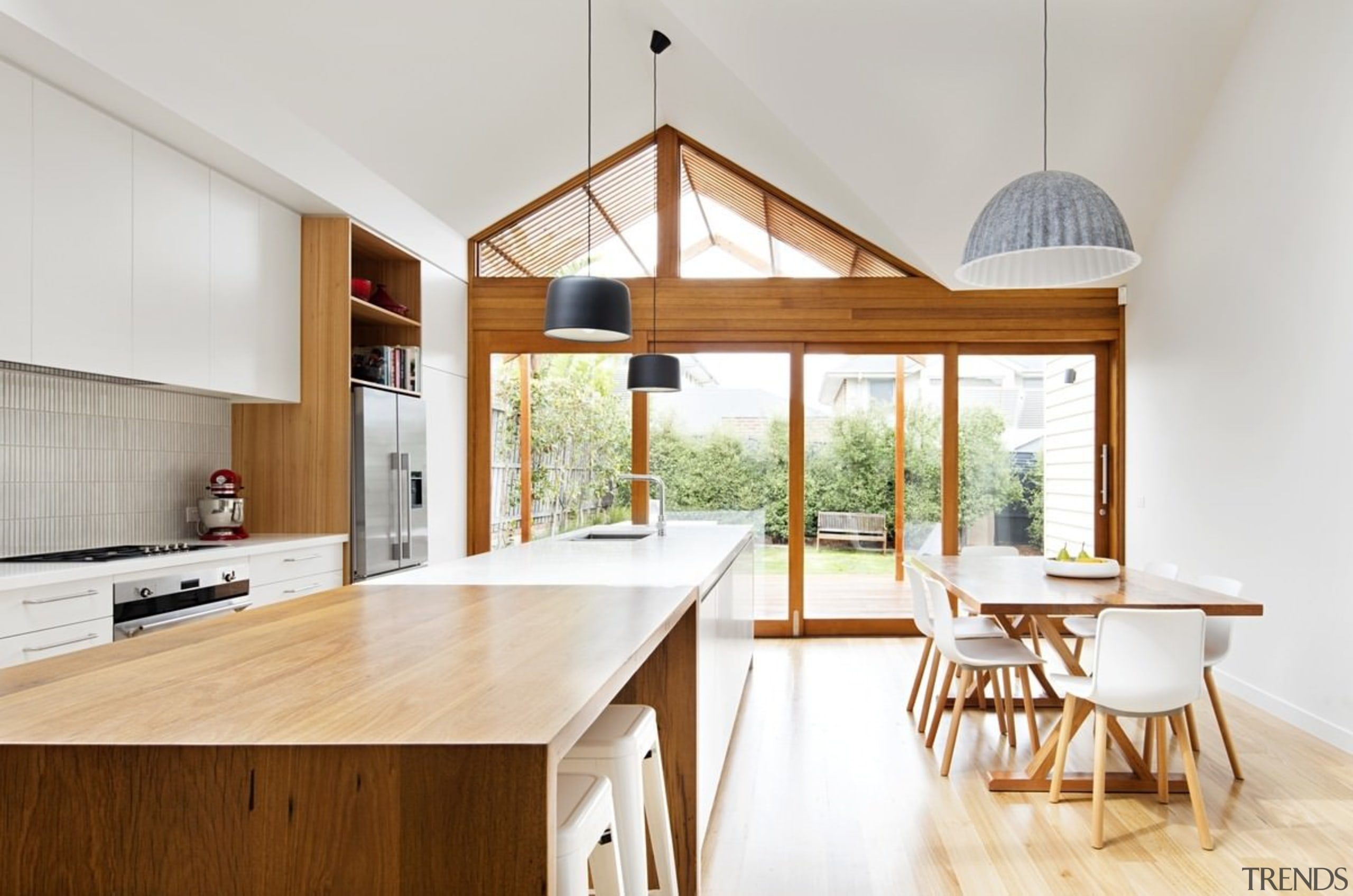The island features a dedicated wood bar section architecture, house, interior design, real estate, table, white