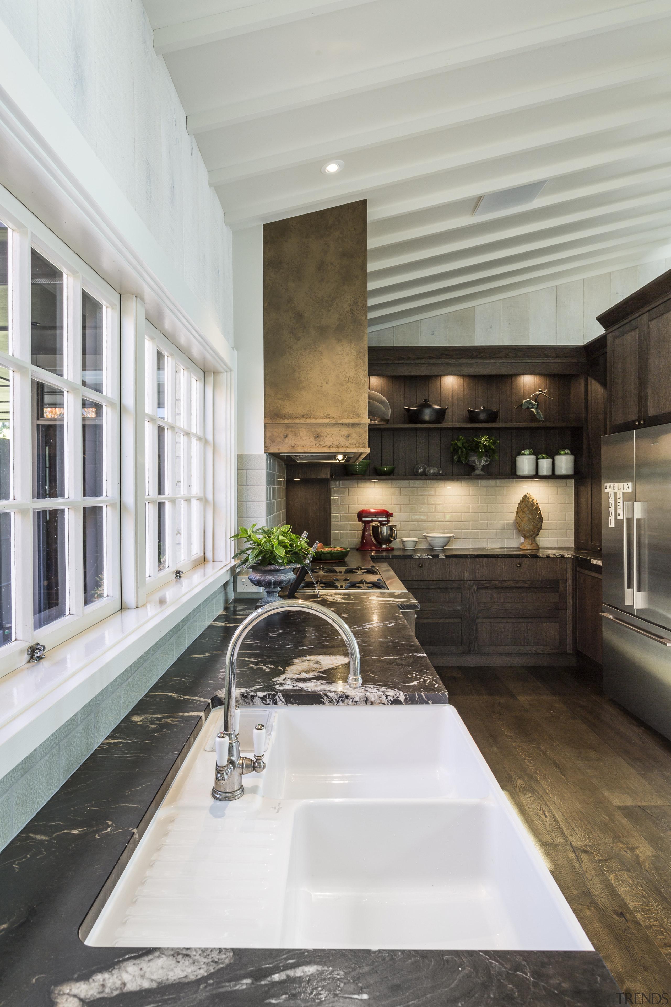 This kitchen by designer Shane George of Kitchens gray, white