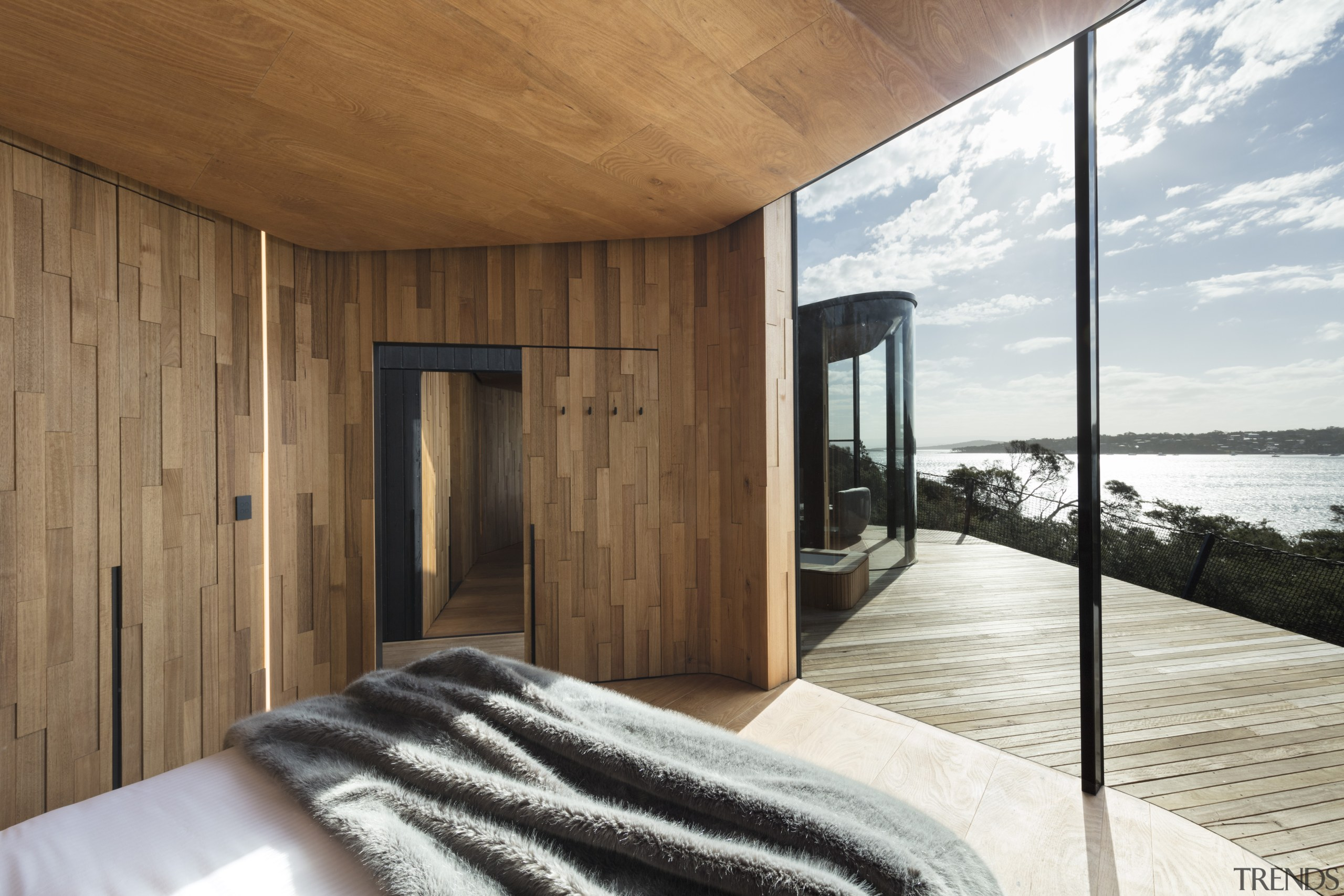 This coastal pavilion features local timber inside and