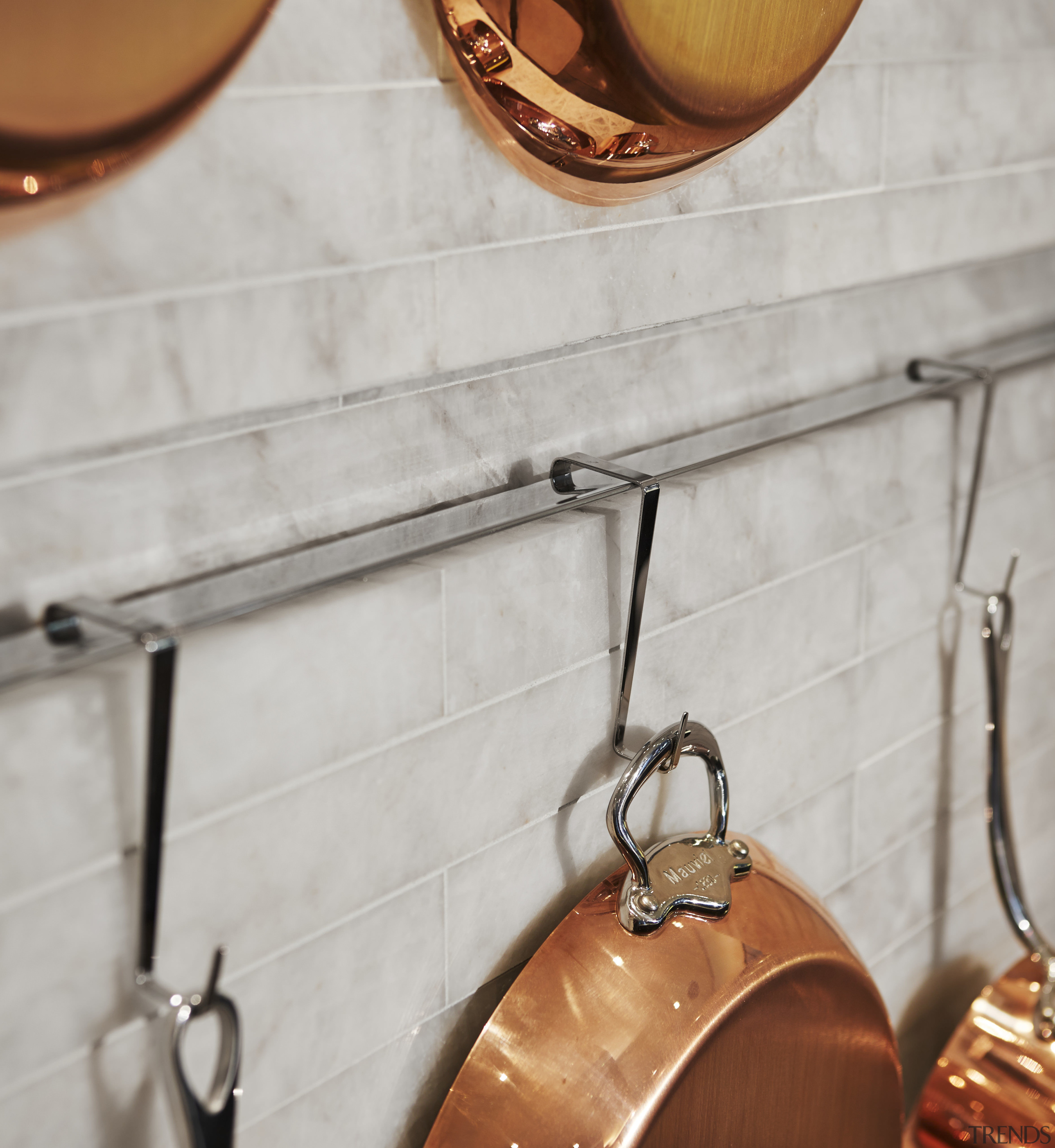 A recessed channel  lined with polished stainless copper, floor, flooring, lamp, lighting, metal, gray