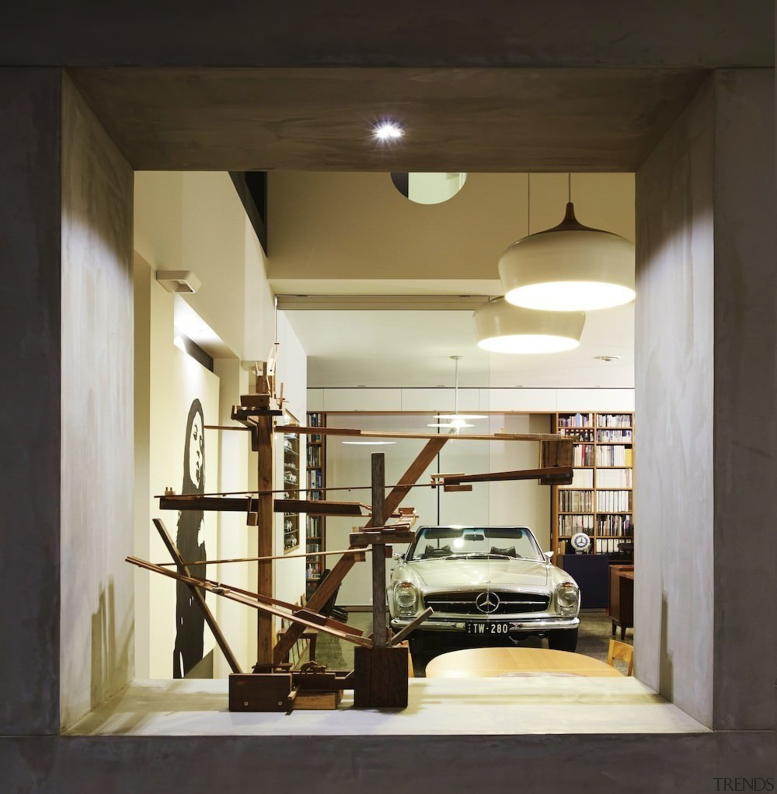 This garage/library/sculpture room is the ultimate place to ceiling, furniture, interior design, black