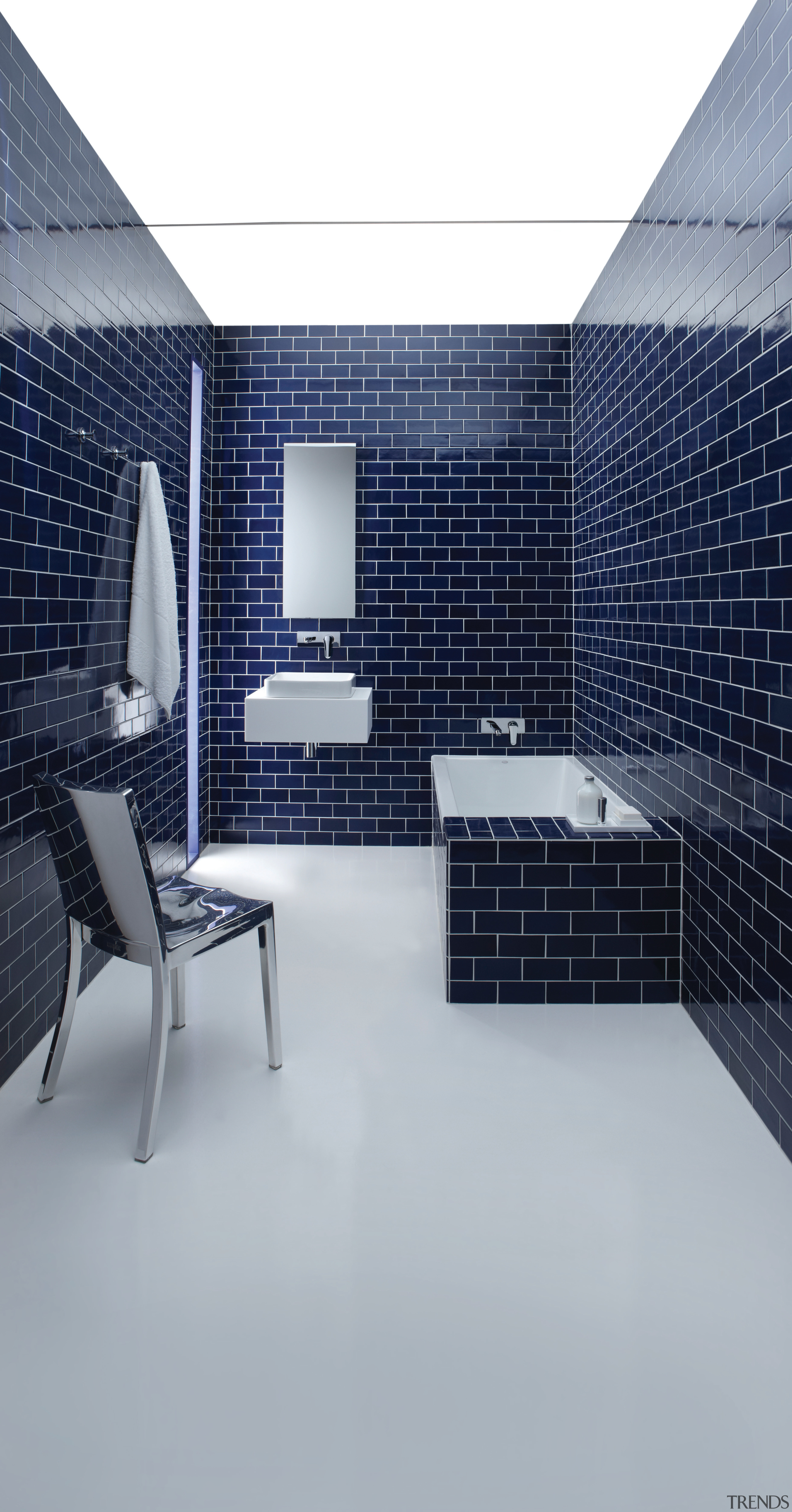 Kohler products feature in this dramatic bathroom. They architecture, daylighting, floor, flooring, furniture, interior design, product design, tile, wall, gray, blue