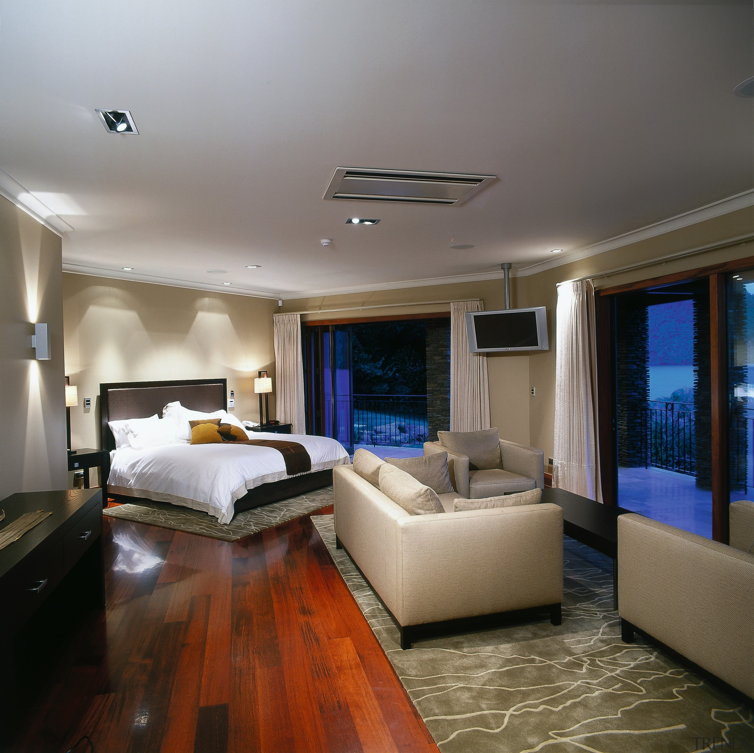 Broad view of the master bedroom. This bedroom ceiling, floor, interior design, living room, real estate, room, suite, gray, brown