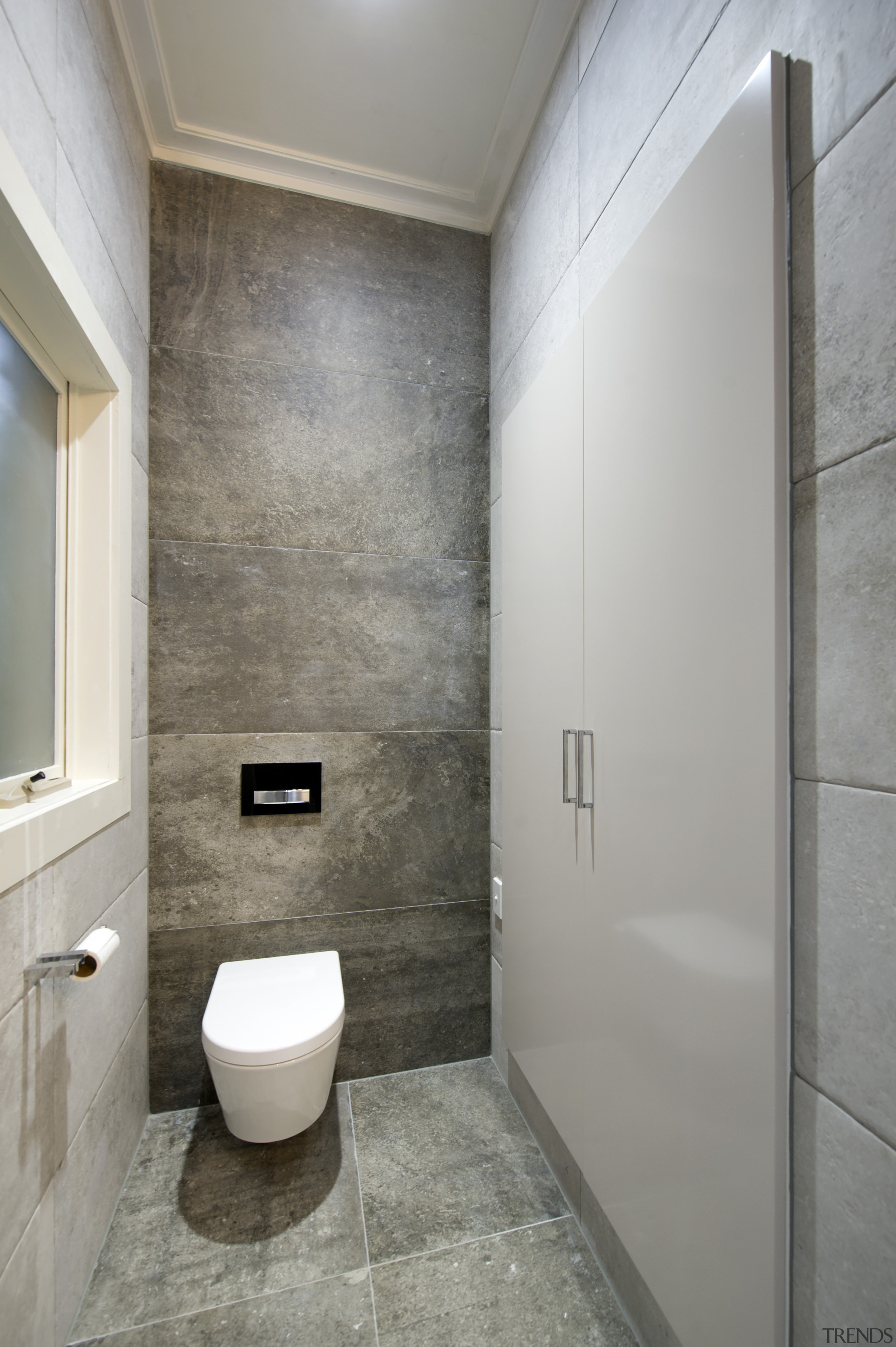 In this project by Bubbles Bathrooms, the toilet architecture, bathroom, daylighting, floor, interior design, plumbing fixture, real estate, room, tile, toilet, wall, gray