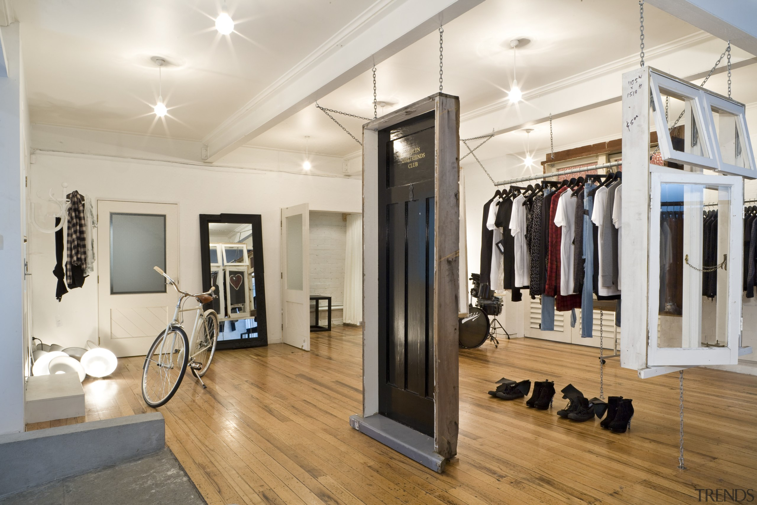 Interior view of the clothing displays at the boutique, floor, flooring, interior design, real estate, room, white