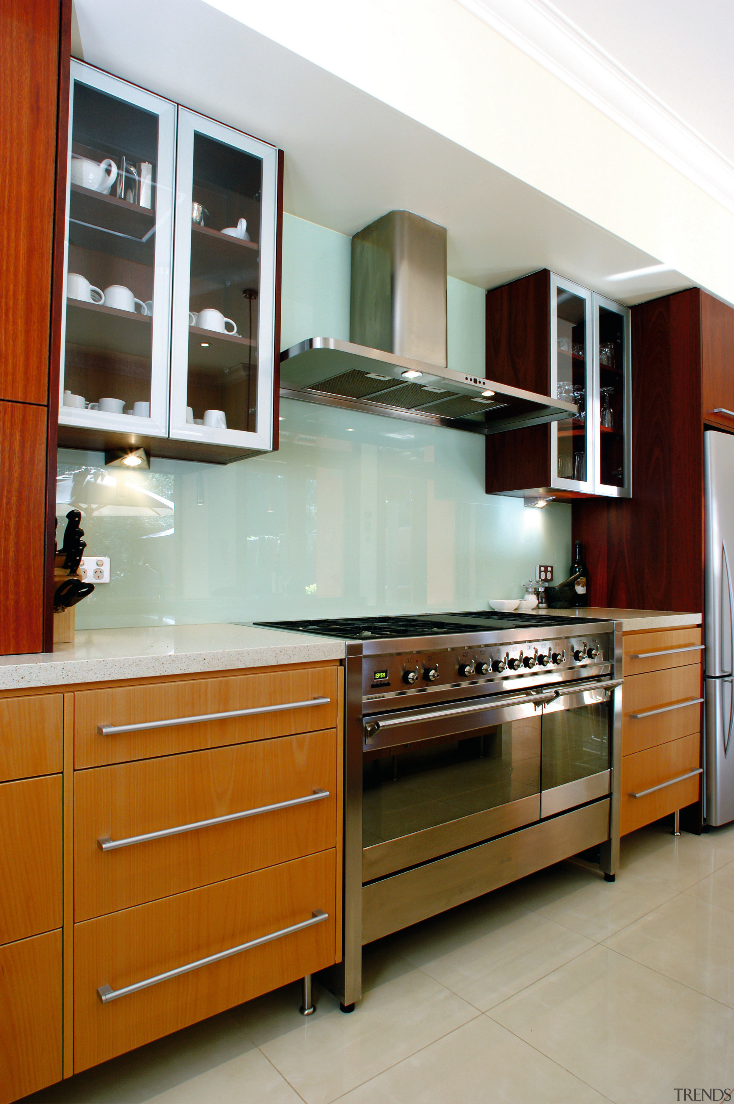 A view of a kitchen with Omega Smeg cabinetry, countertop, cuisine classique, furniture, interior design, kitchen, room, gray, brown