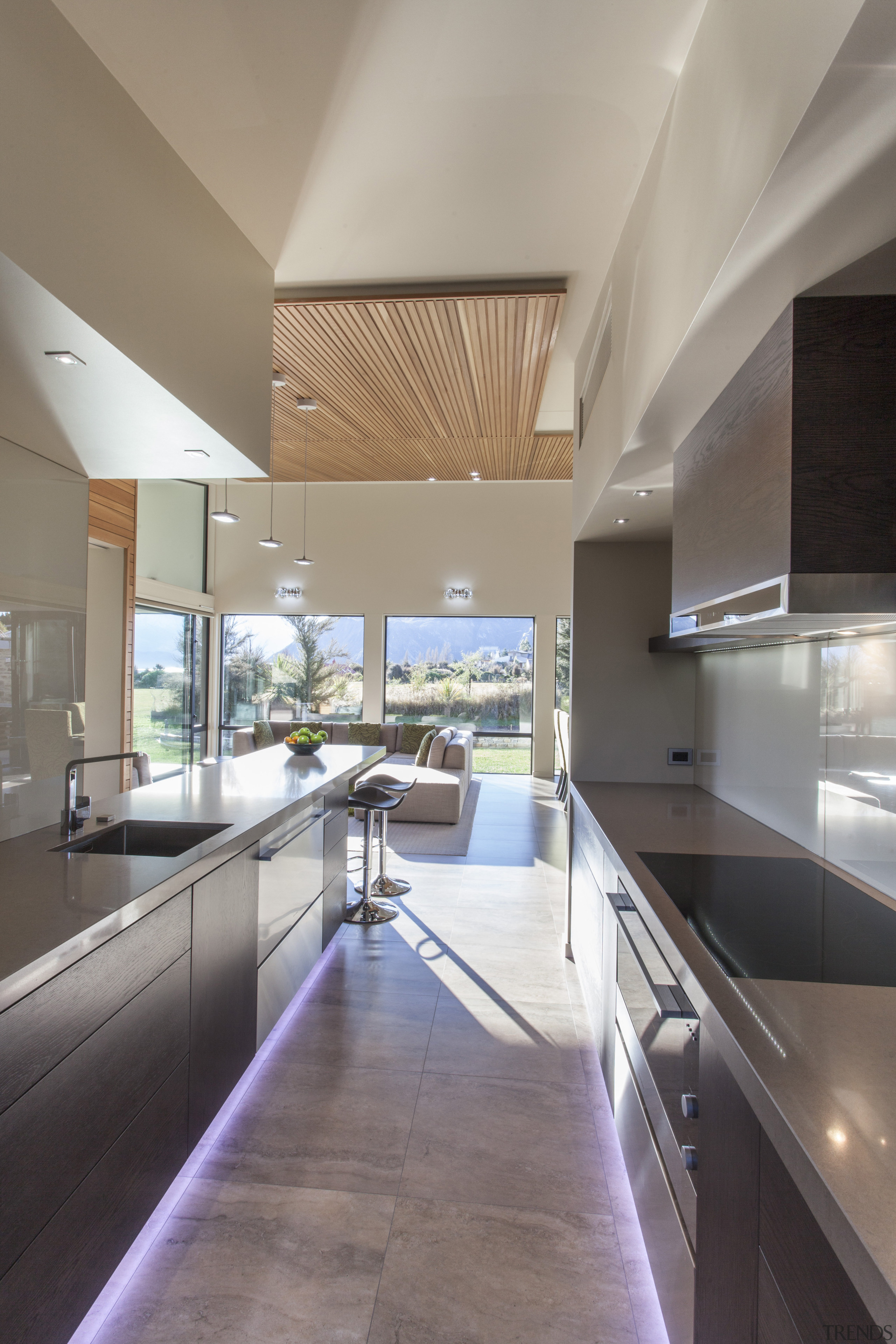 The kitchen of this country house includes a architecture, ceiling, countertop, daylighting, estate, floor, house, interior design, kitchen, real estate, gray