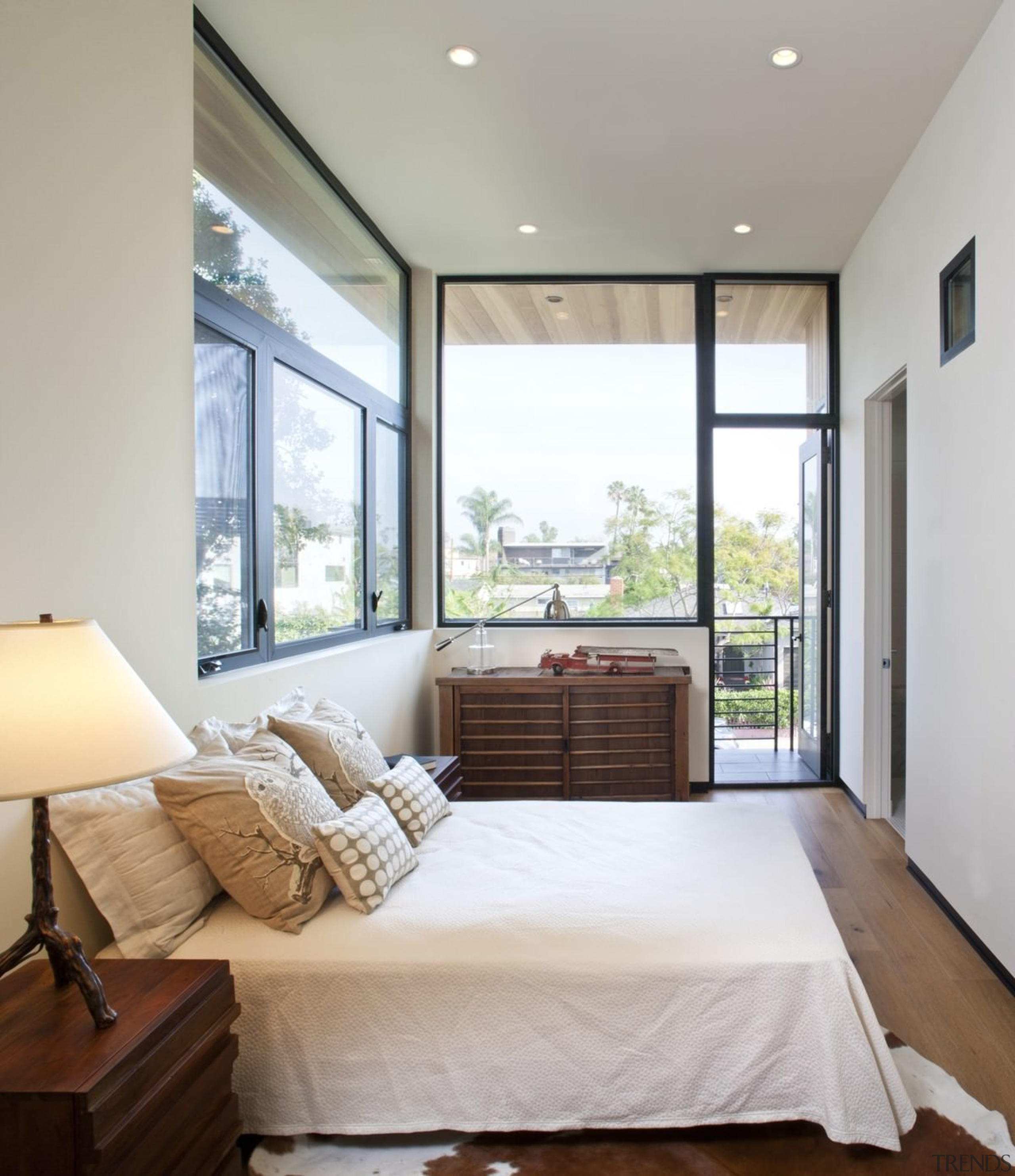 This bedroom looks out to a leafy neighbourhood architecture, bed frame, bedroom, ceiling, daylighting, estate, floor, home, house, interior design, living room, property, real estate, room, window, wood, gray