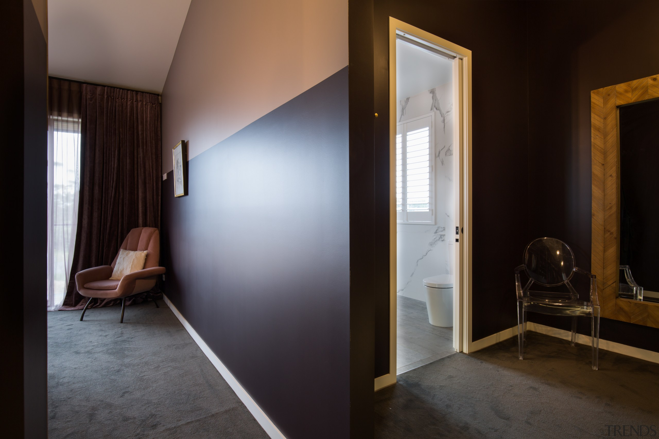 The space planning emphasises movement towards the bathroom architecture, ceiling, daylighting, door, floor, home, house, interior design, real estate, room, wall, window, wood, black, gray