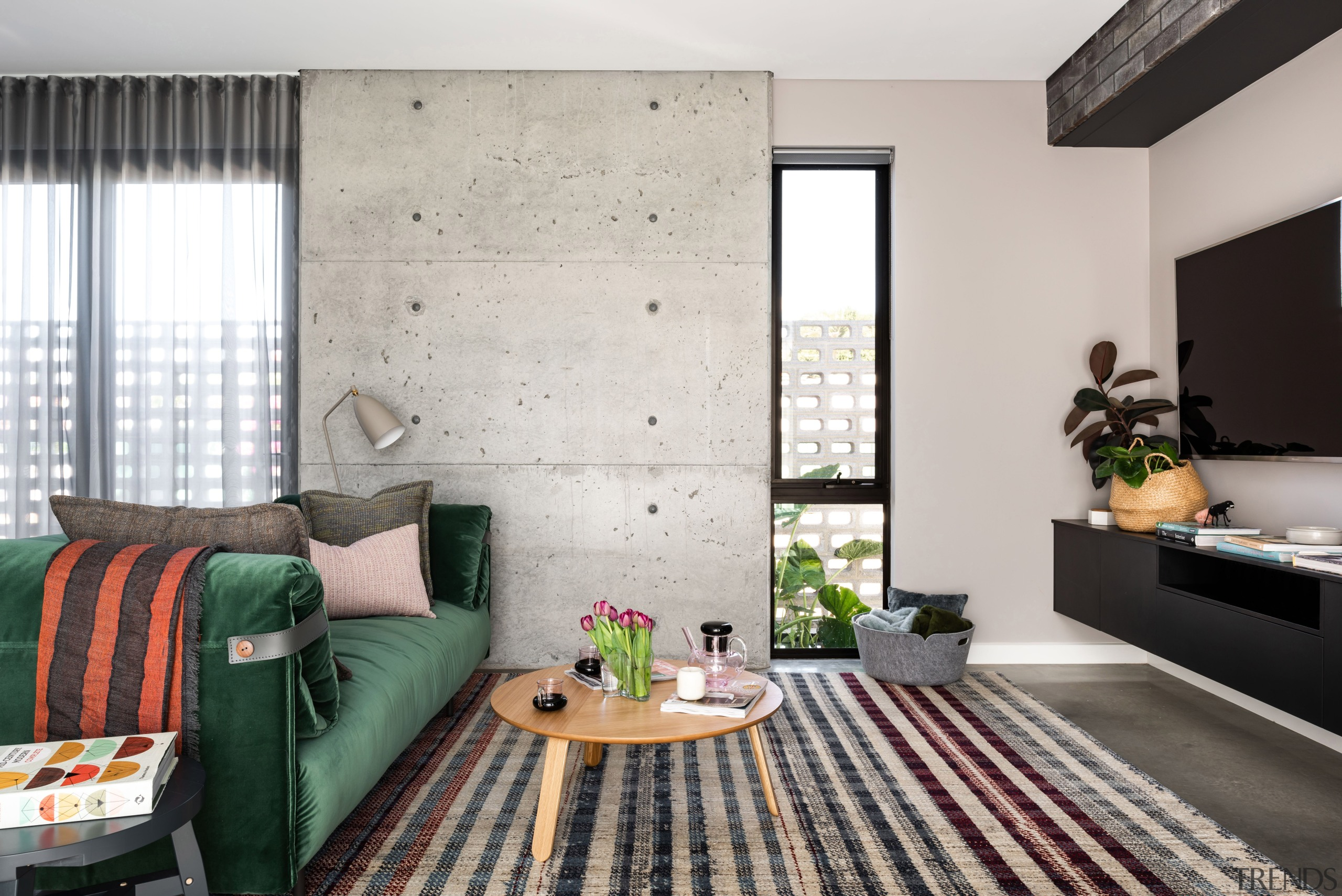 Rough with the smooth – a poured-in-situ feature architecture, coffee table, couch, curtain, floor, flooring, furniture, green, home, house, interior design, living room, table, wall, window covering, window treatment, gray, Dalecki Design
