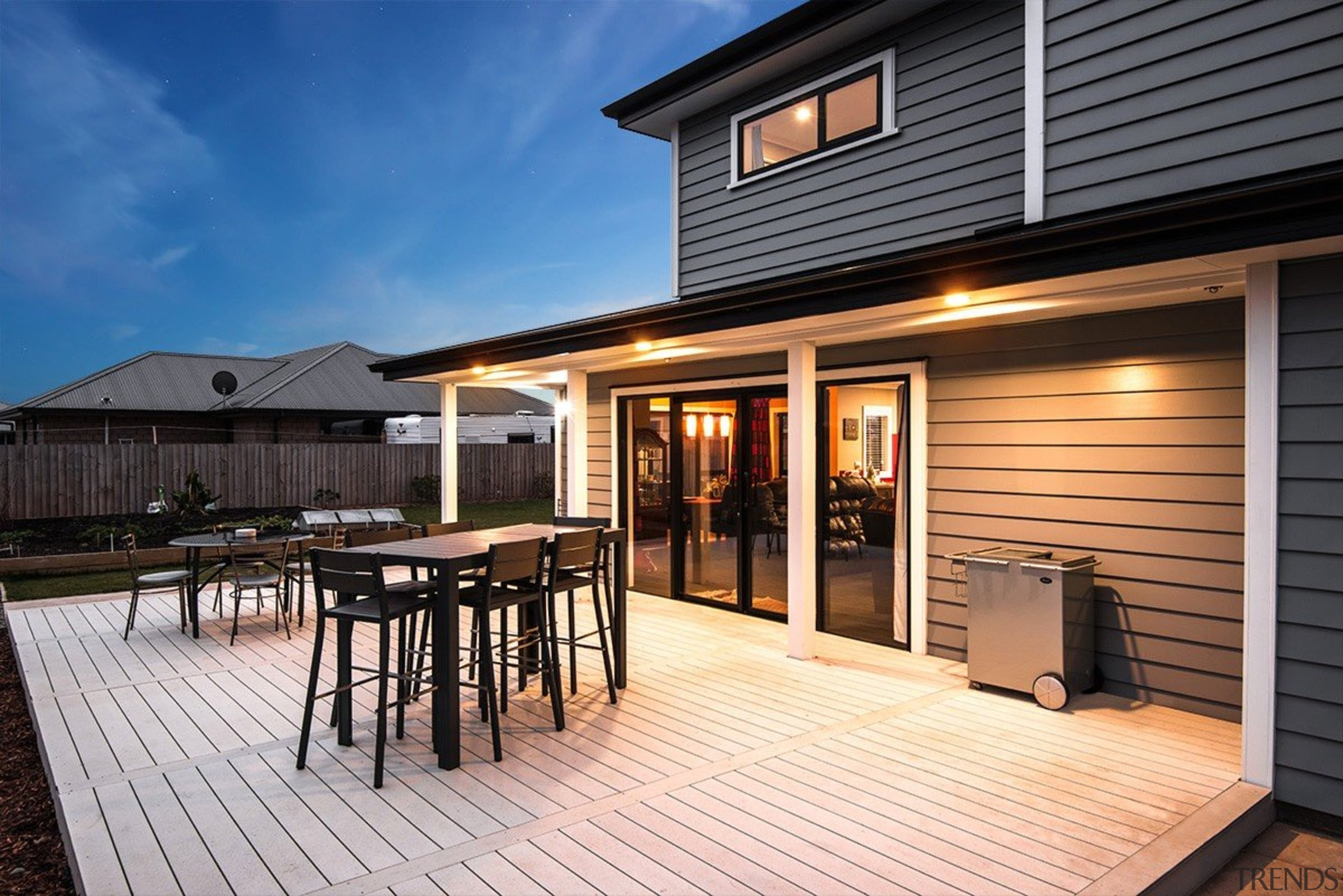 A new home clad with Envira Weatherboard System deck, home, house, outdoor structure, property, real estate, siding, window, black
