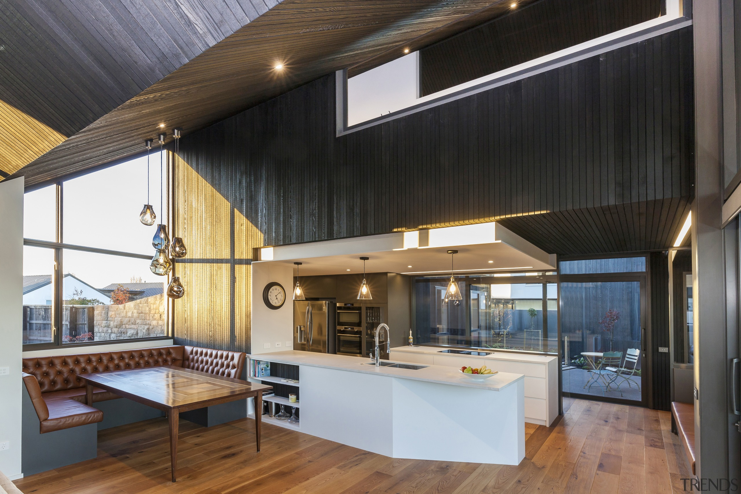 The timber ceiling, responding to the roofline, gives
