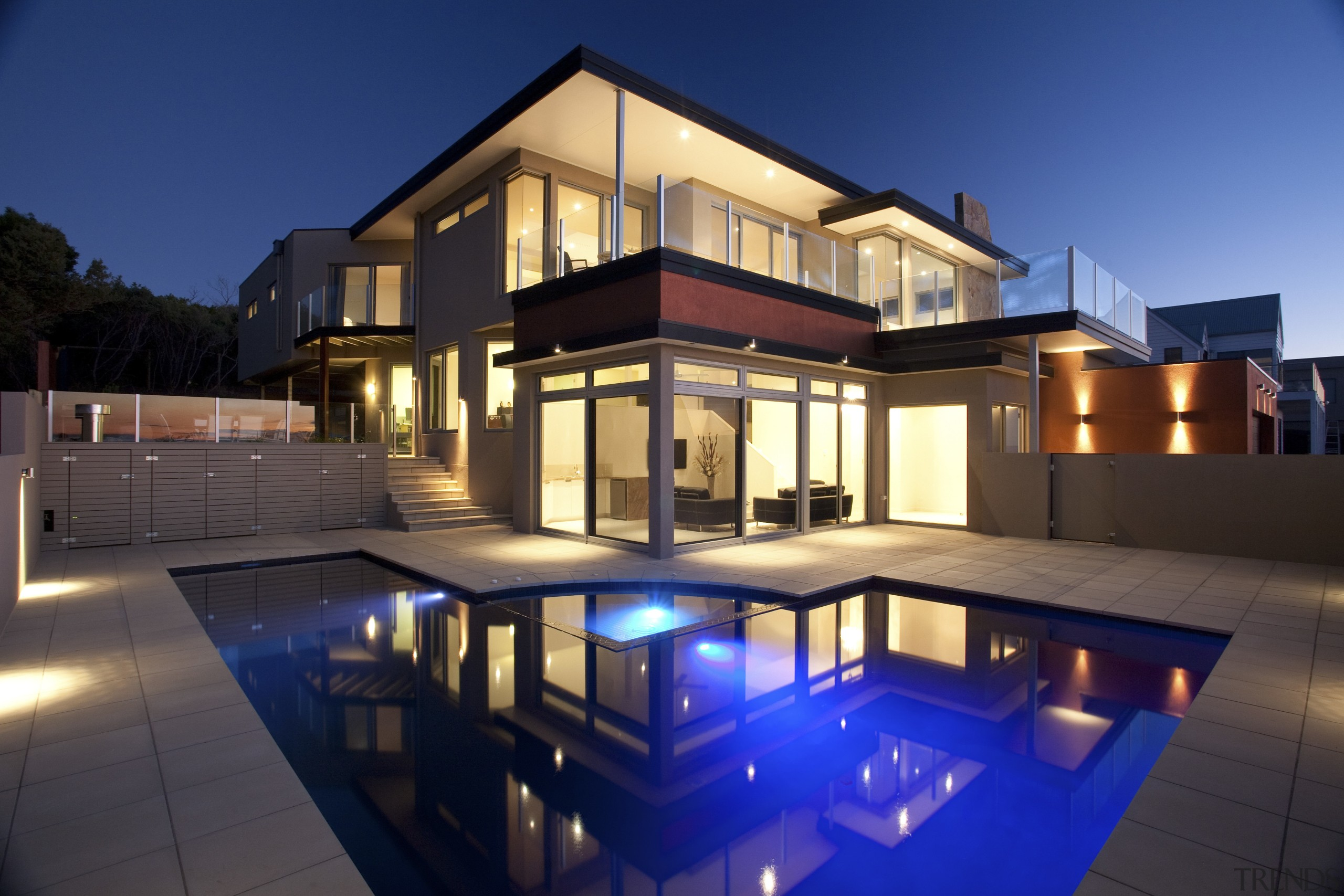 Contemporary home designed and built by Graeme Alexander apartment, architecture, building, elevation, estate, facade, home, house, lighting, mixed use, property, real estate, residential area, swimming pool, villa, window, blue