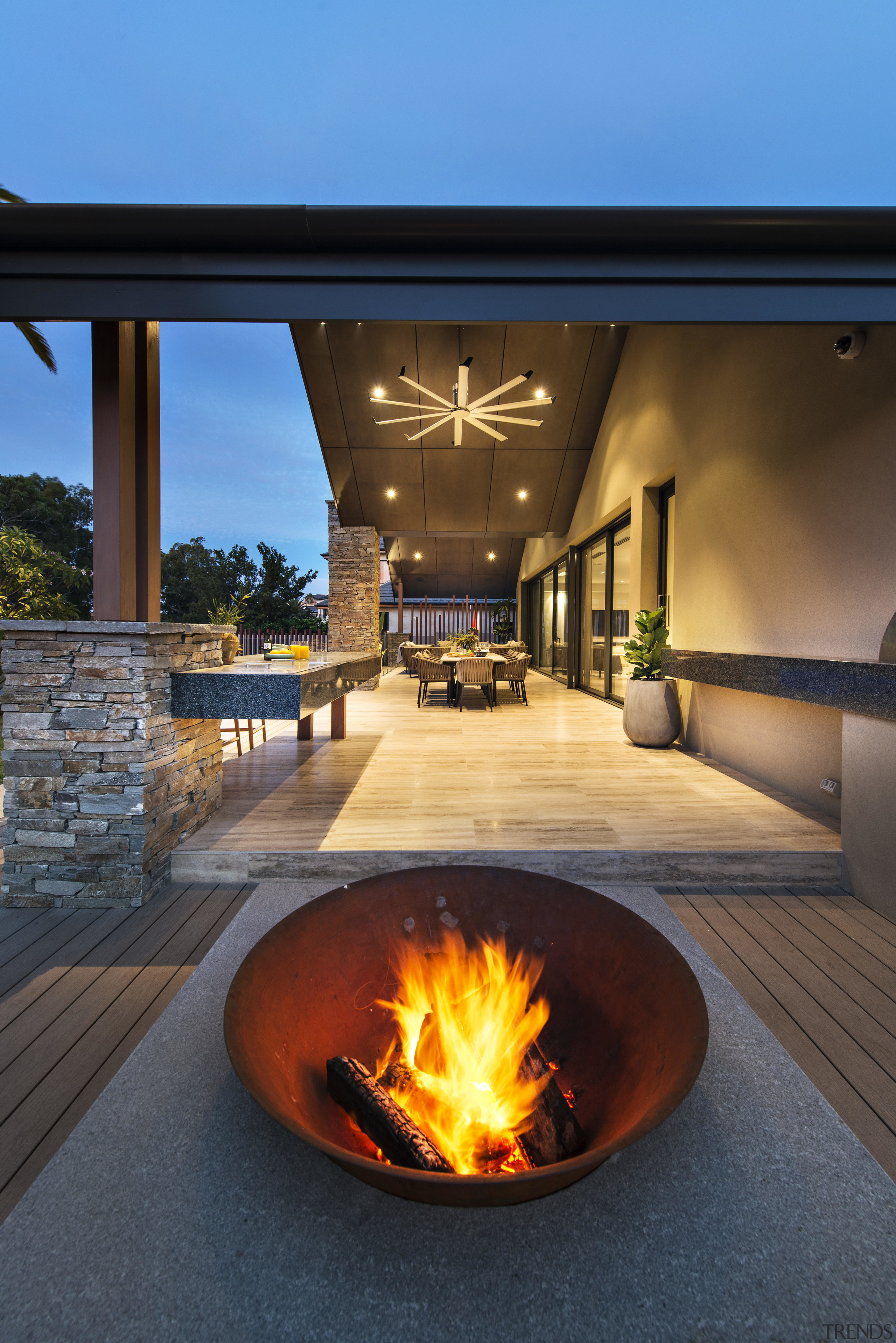 The spun-steel firepit sits on a granite slab. fireplace, heat, home
