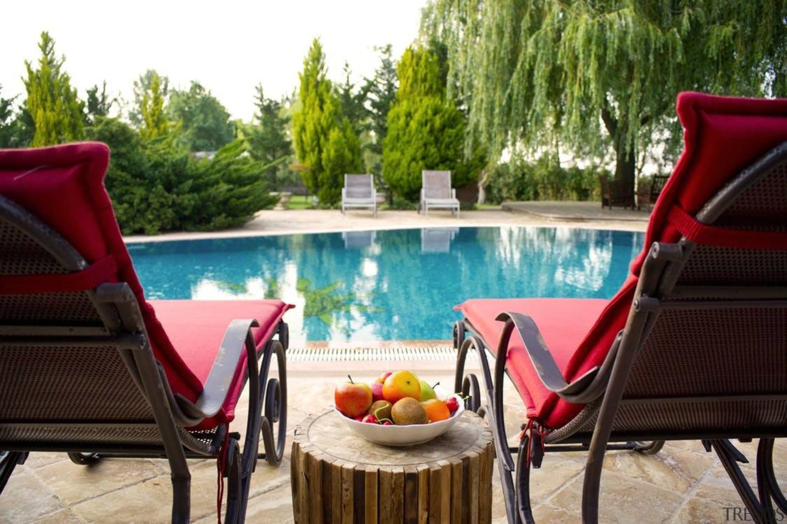 Is there a better outdoor gathering spot? - backyard, chair, estate, furniture, home, leisure, outdoor furniture, outdoor structure, patio, property, real estate, resort, sunlounger, swimming pool, table, vacation