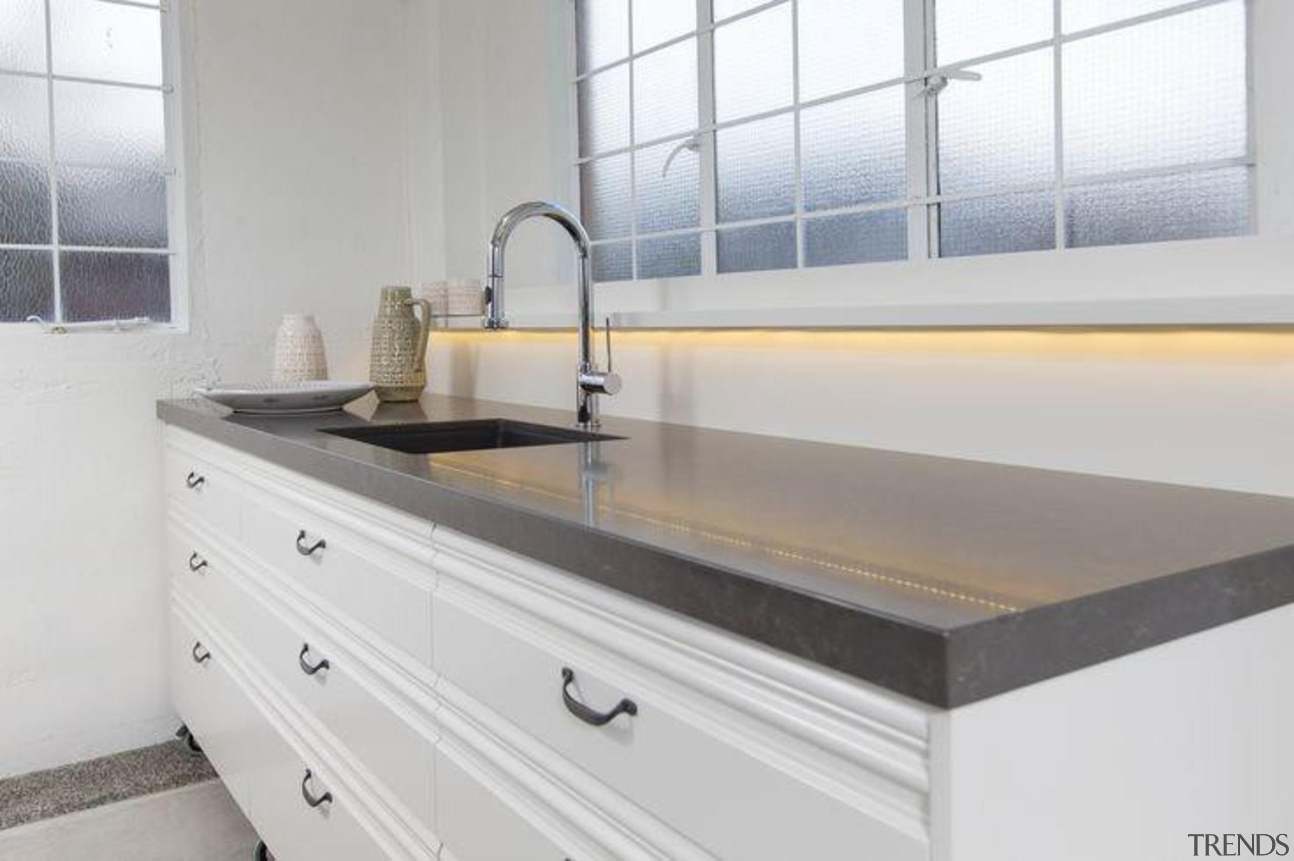 By Sally Steer Design, Wellington NZ. Caesarstone Piatra bathroom sink, countertop, kitchen, plumbing fixture, product design, sink, tap, gray