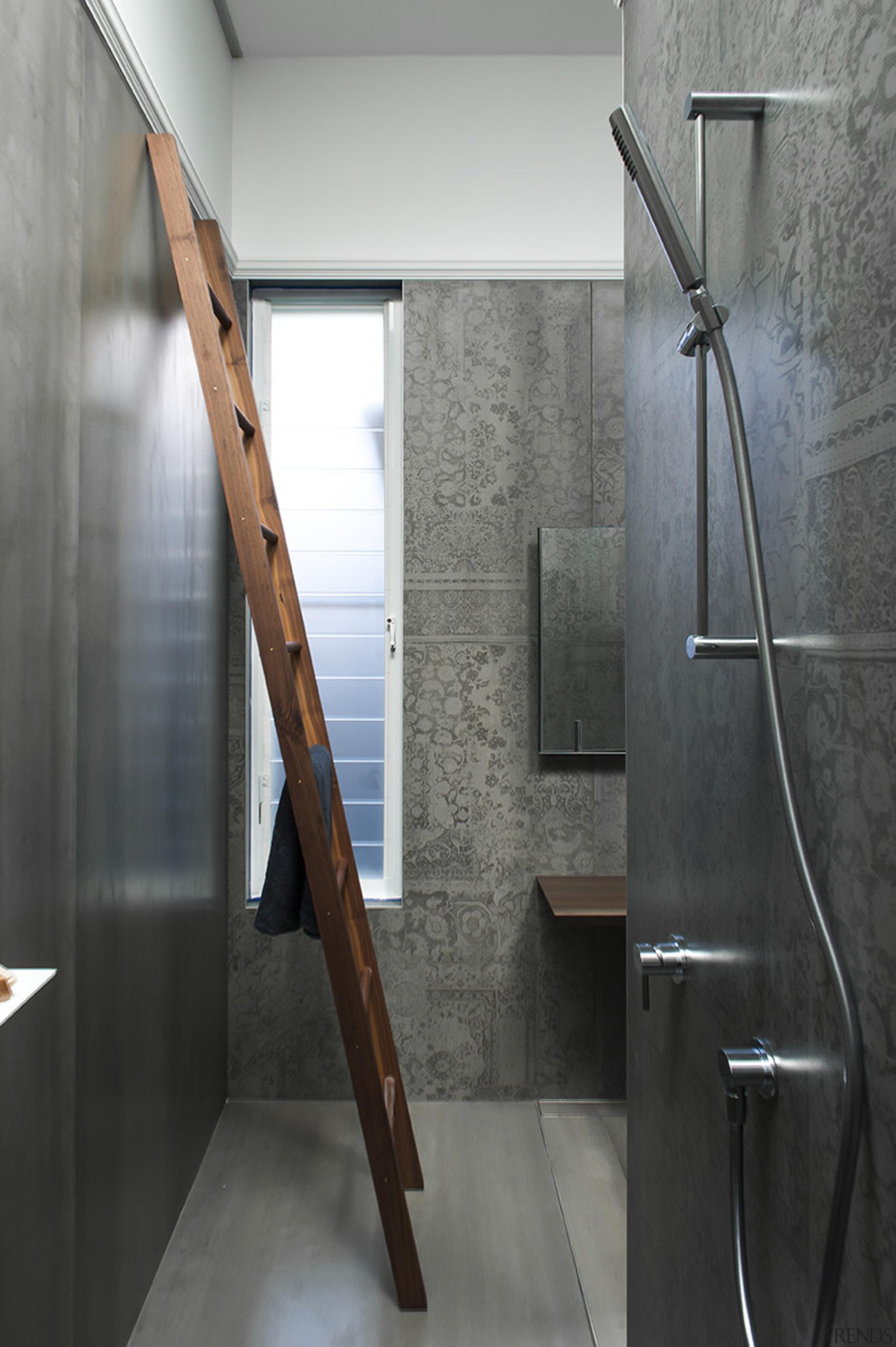 An almost room-height ladder in walnut – matching floor, flooring, handrail, interior design, tap, gray, black, Minosa Design,
