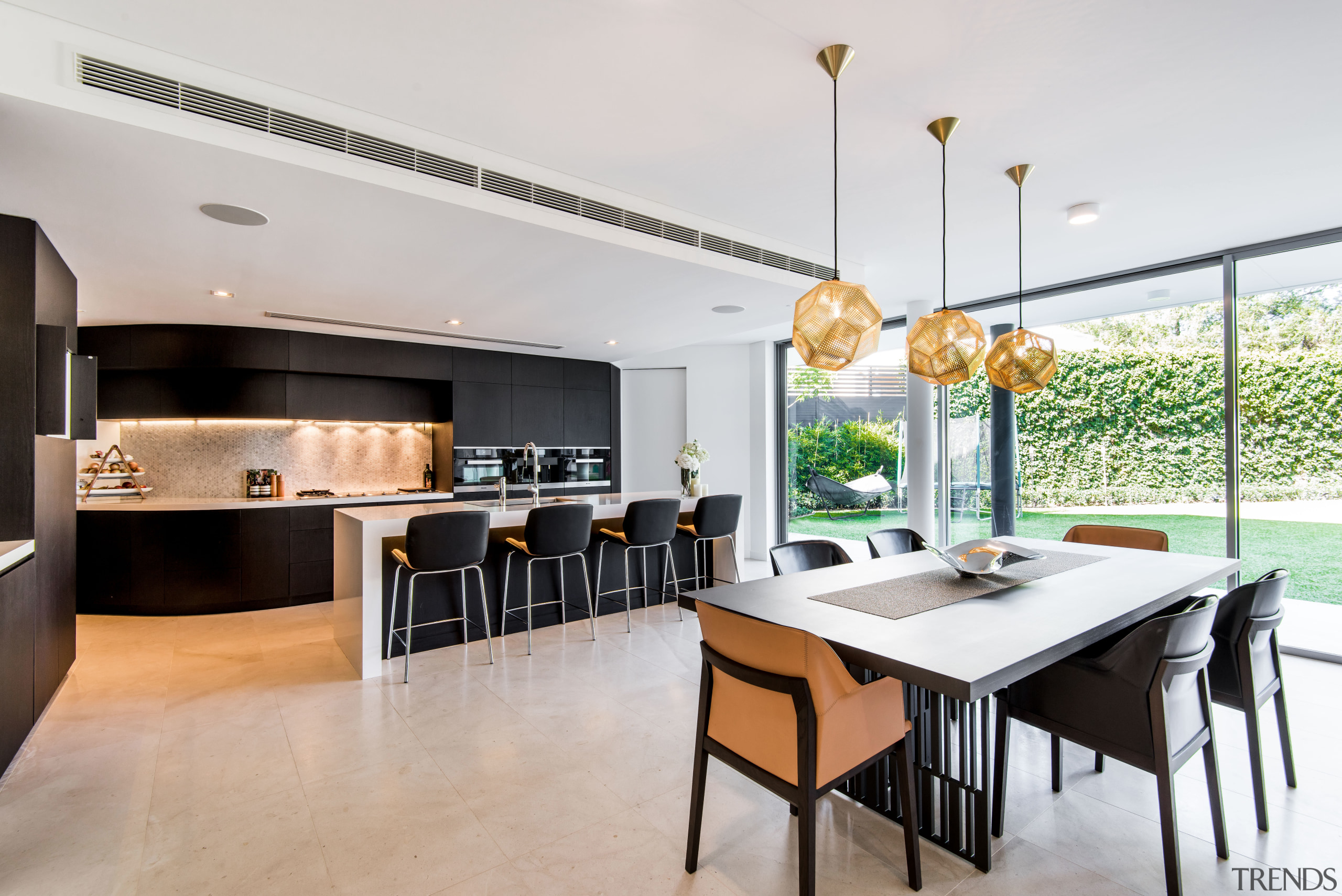 This two-tone kitchen by Hillam Architects combines white interior design, kitchen, real estate, gray, white