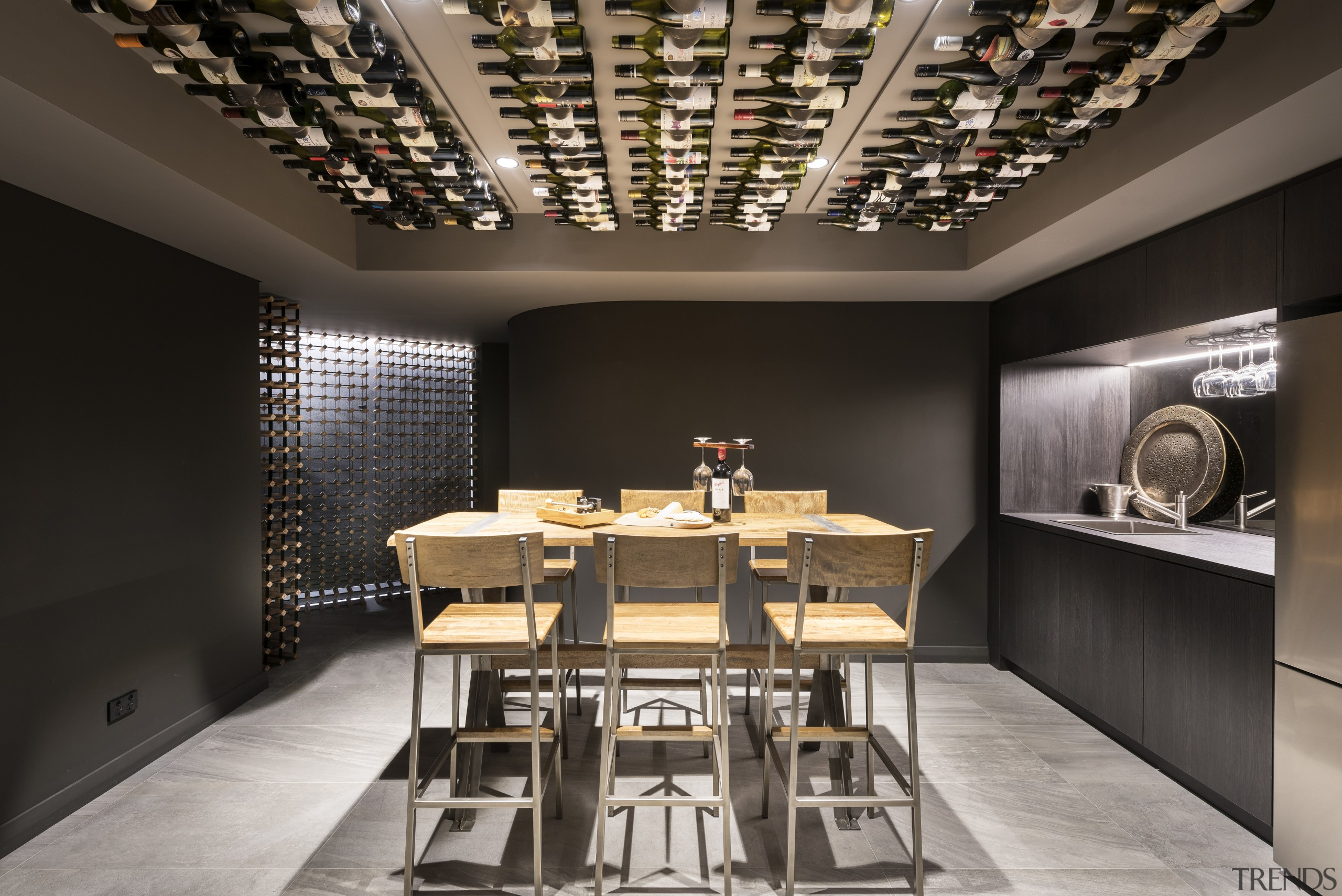 Wine cellar – contemporary new home by Urbane ceiling, dining room, interior design, table, black, gray