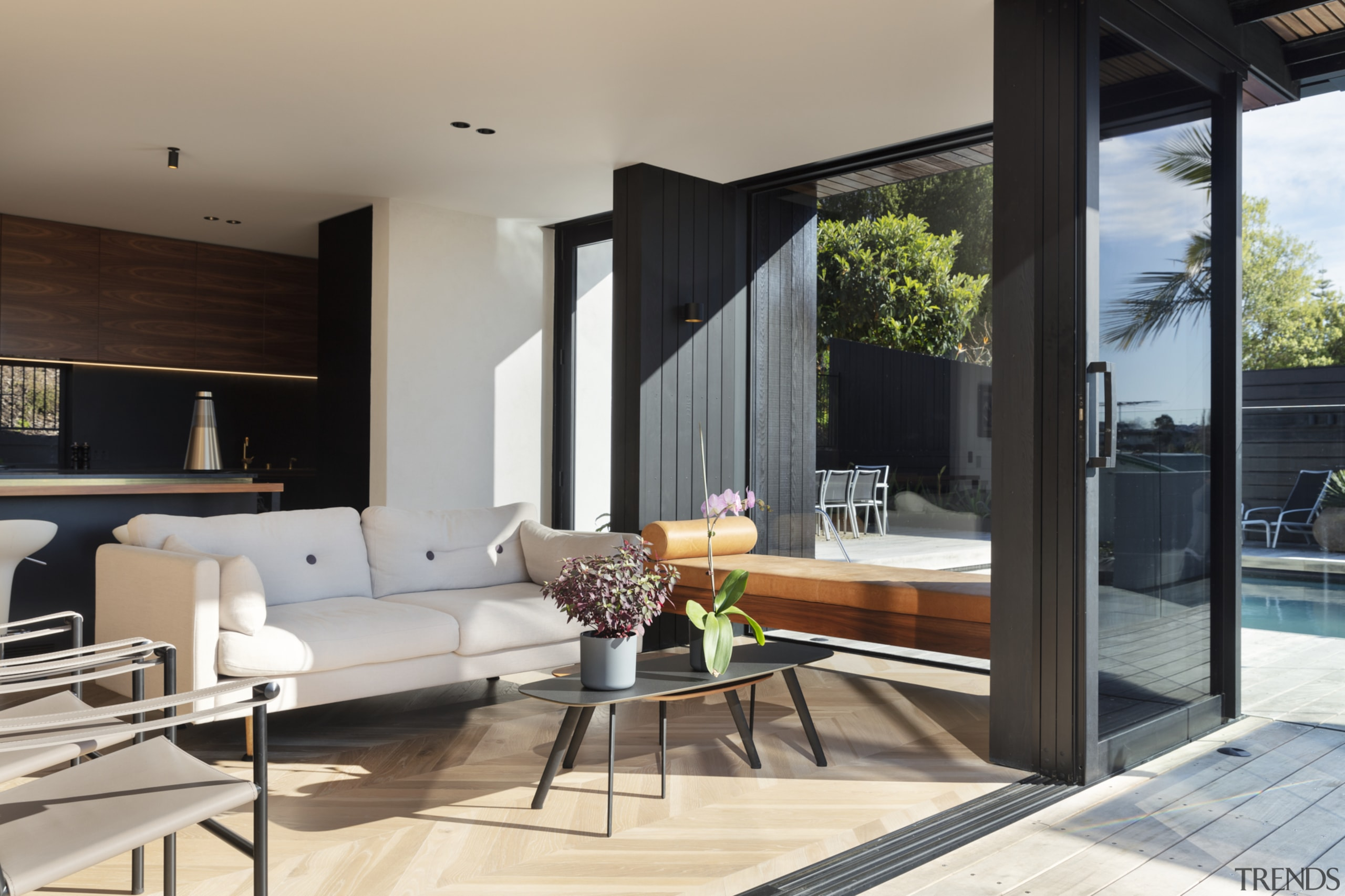 1970's home becomes a modern entertainer's dream - apartment, architecture, building, ceiling, coffee table, design, door, floor, flooring, furniture, hardwood, home, house, interior design, living room, property, real estate, room, table, window, wood flooring, gray, black