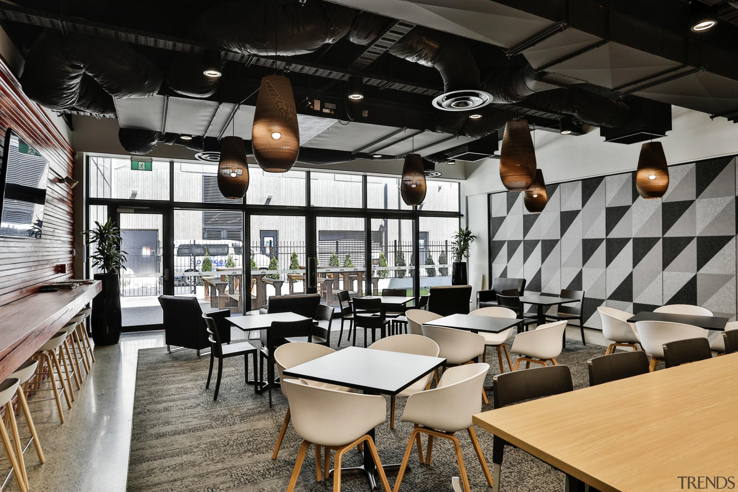 The staff cafe at the new Kathmandu headquarters café, interior design, restaurant, table, black, gray