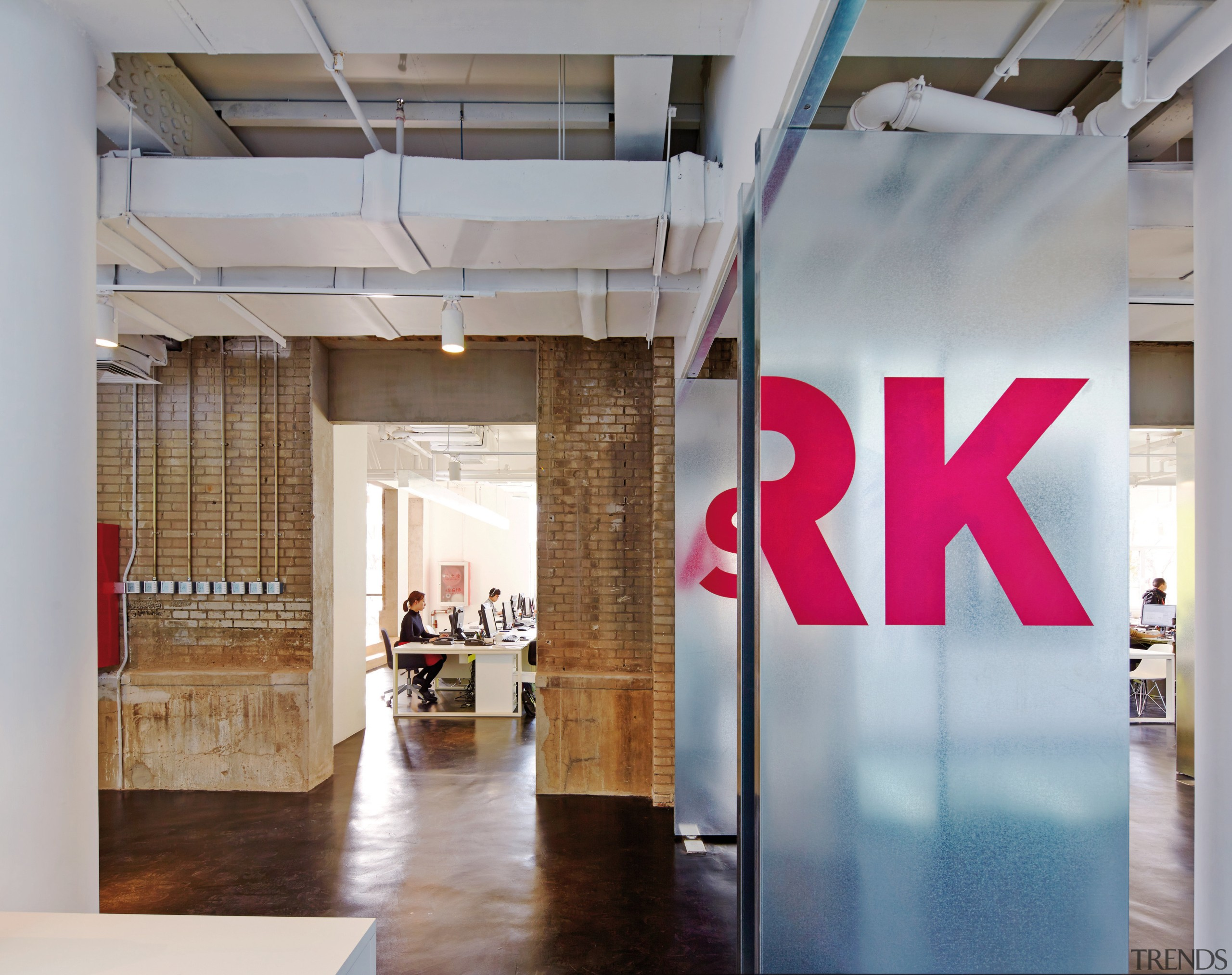 Exposed brick walls and service ducts provide an boutique, ceiling, exhibition, floor, interior design, loft, gray
