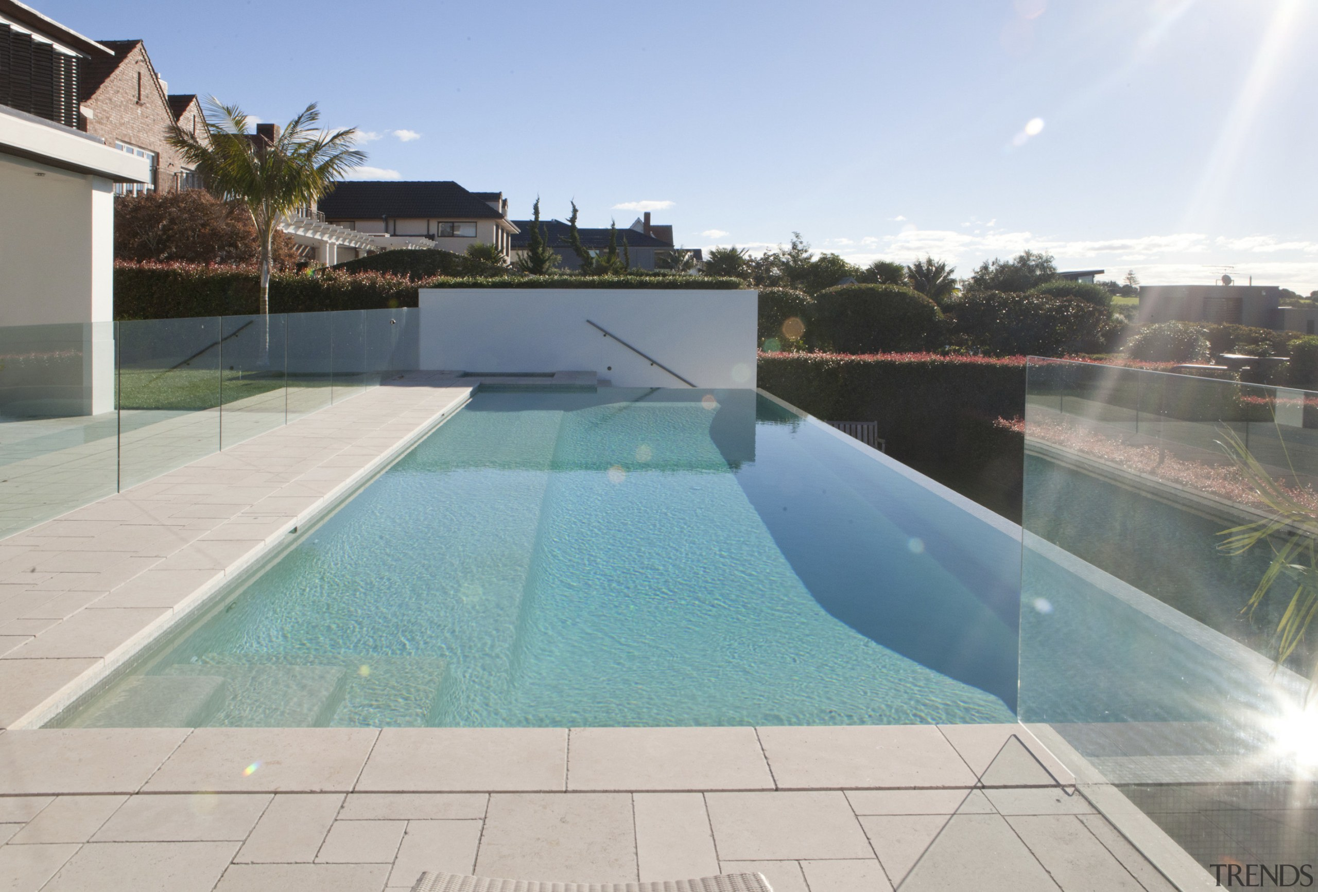 Sunny pool area. - Sunny pool area. - area, estate, leisure, leisure centre, property, real estate, swimming pool, water, gray, teal