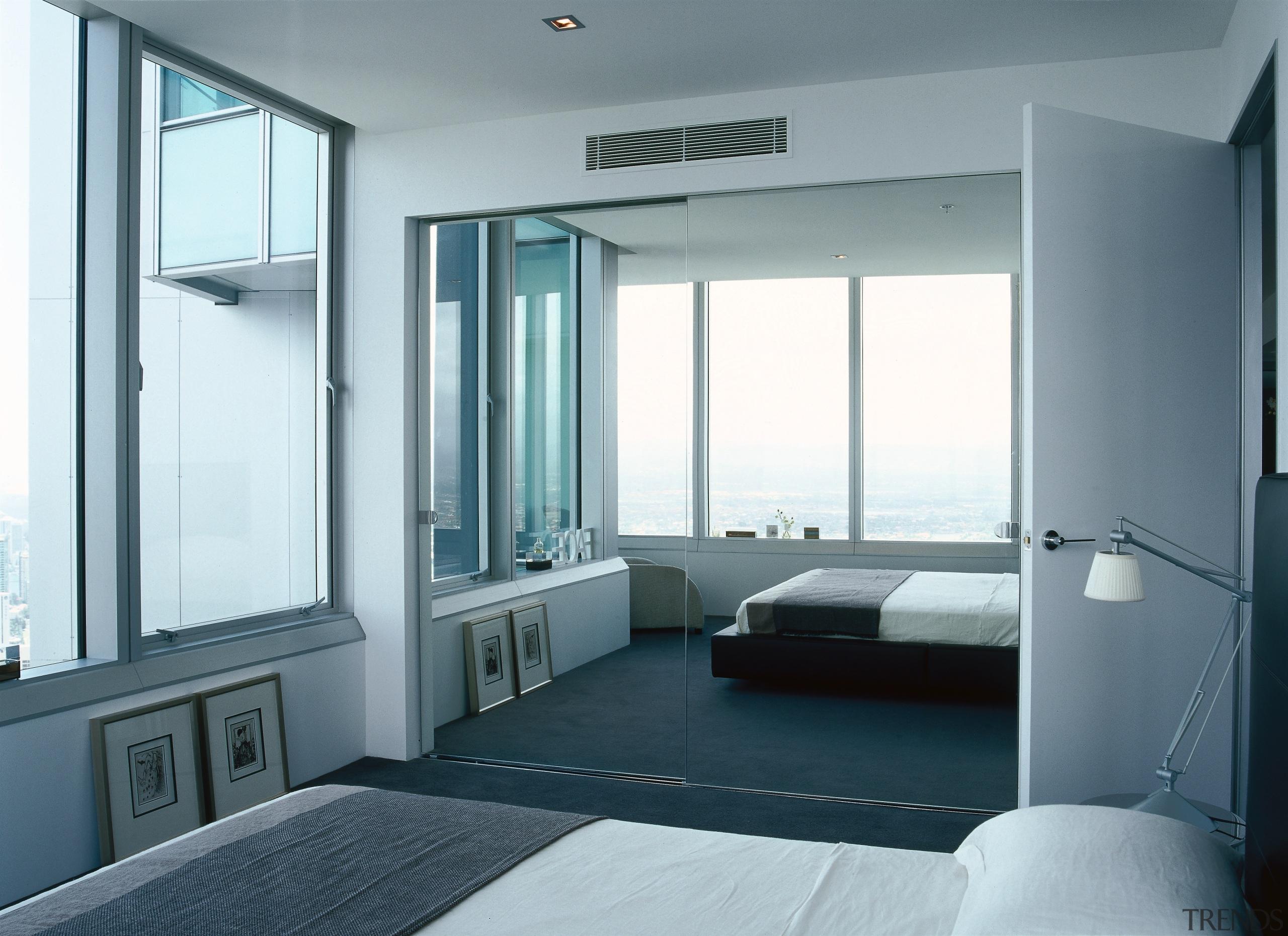 View of mirrored glass of frameless wardrobe doors, architecture, door, interior design, real estate, window, gray, white