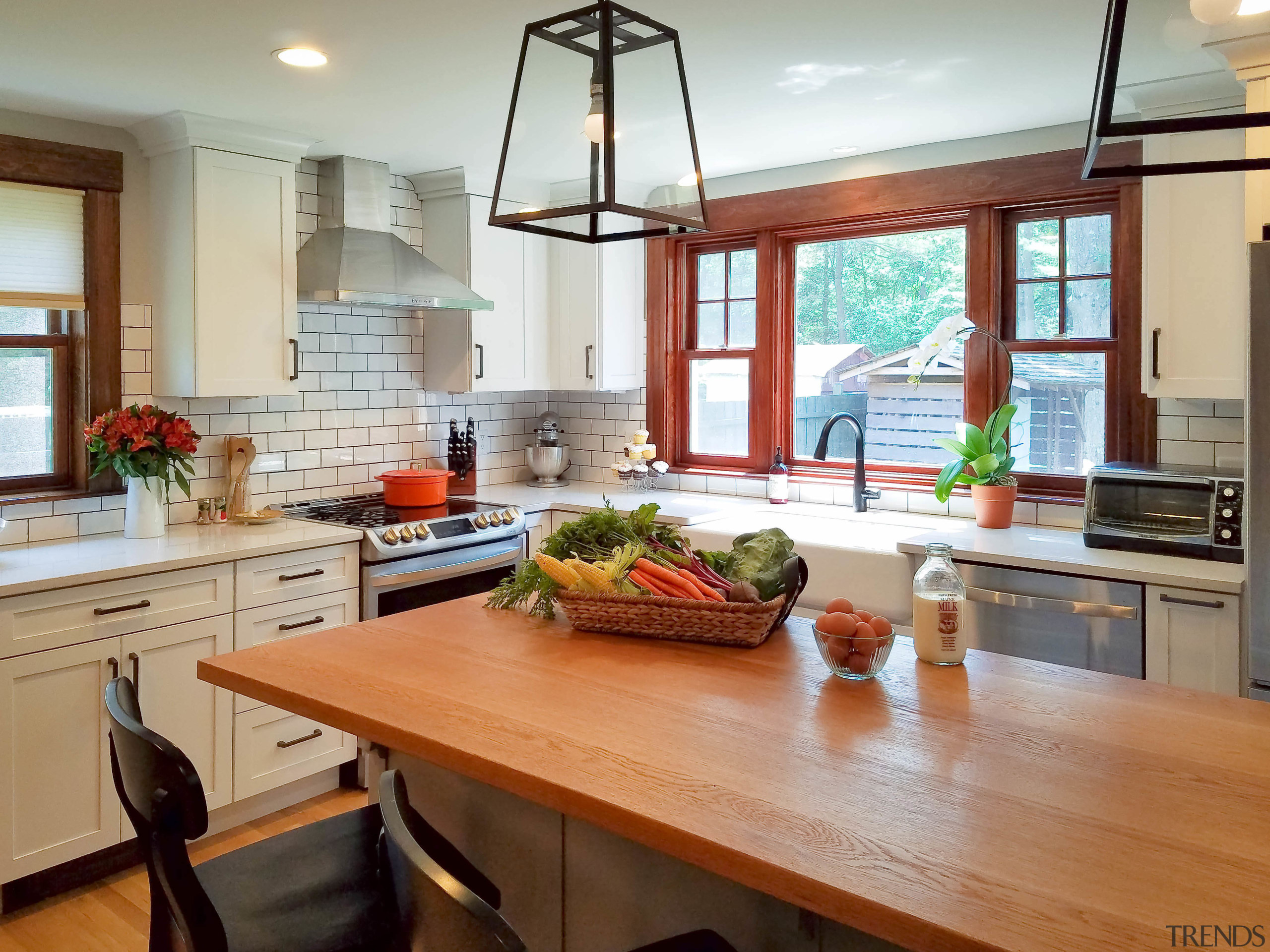 The kitchen certainly has a farmhouse feel to countertop, dining room, hardwood, interior design, kitchen, real estate, room, window, gray