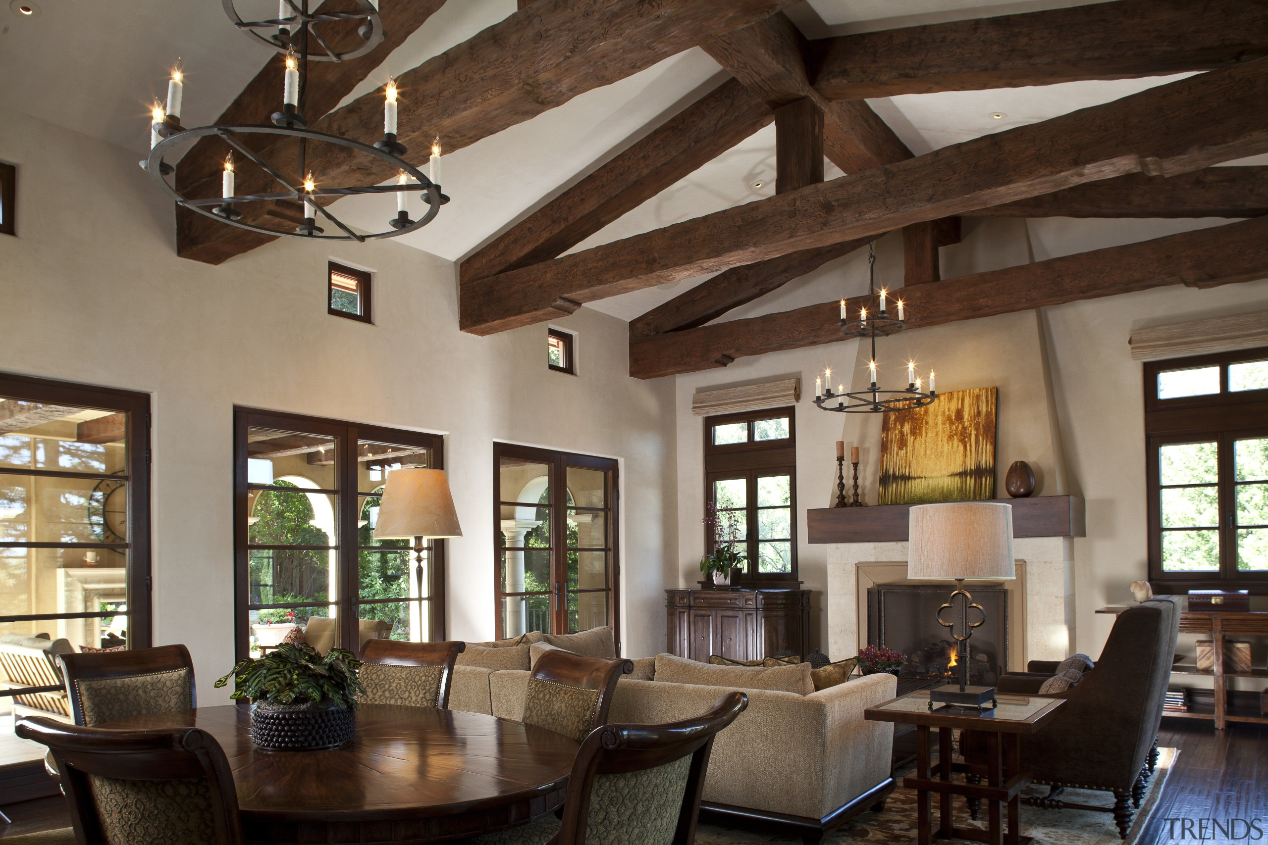 In the family room of this Mediterranean-style Californian beam, ceiling, dining room, interior design, living room, real estate, room, brown