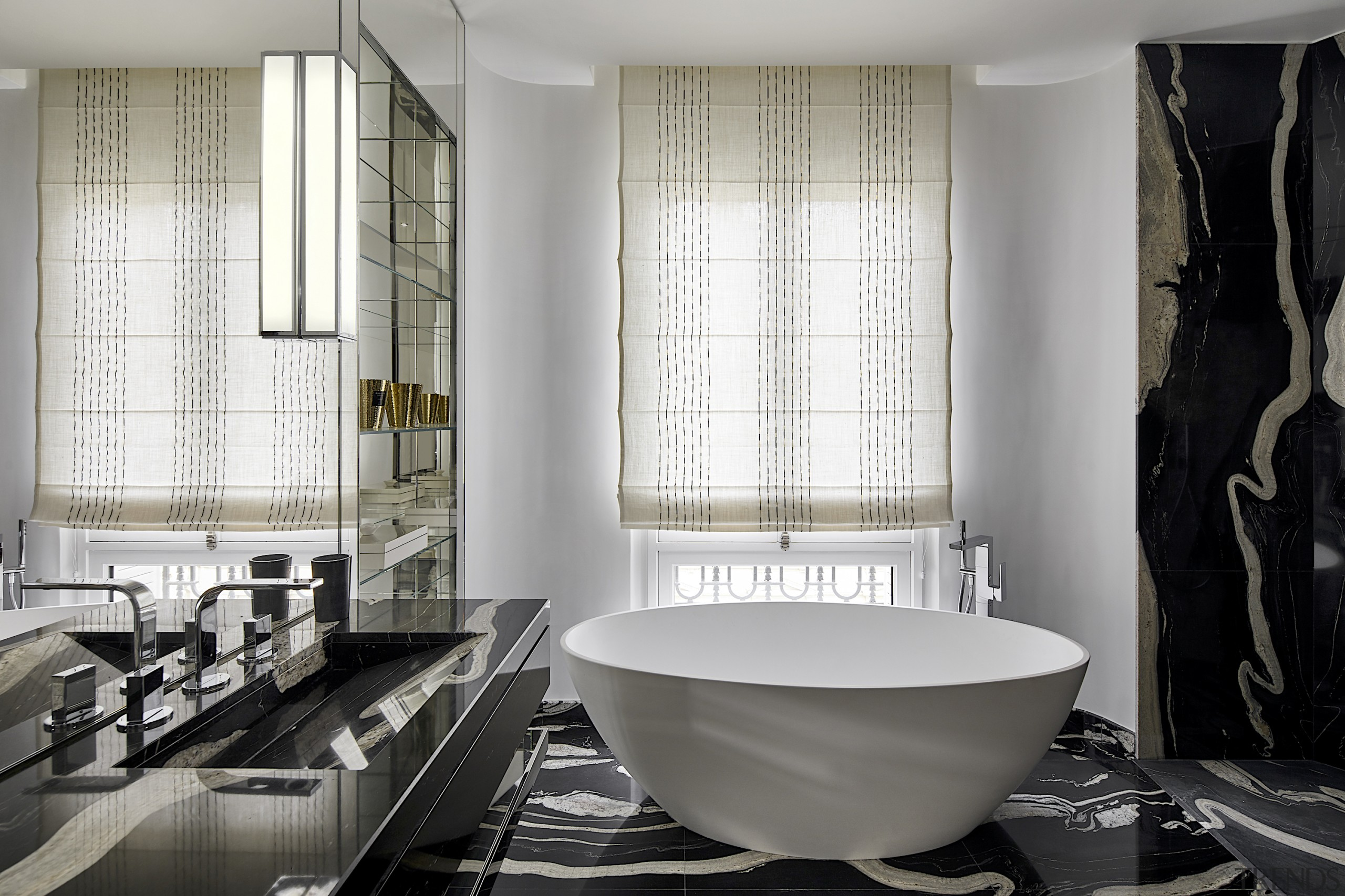 A spectacular black and white marble lays the white, gray