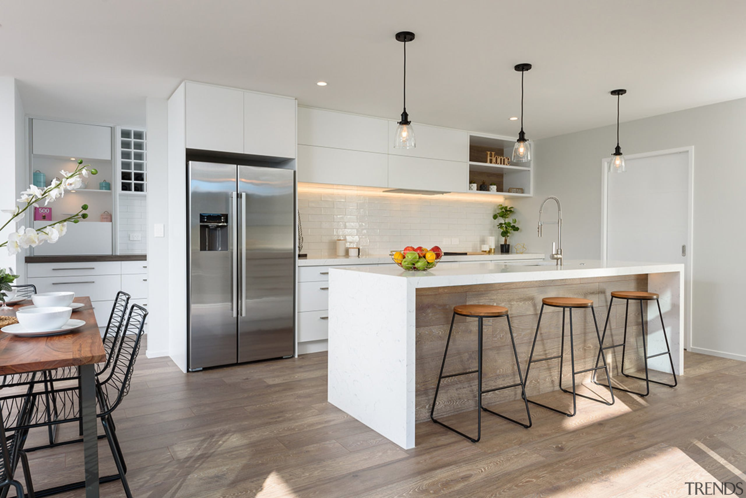 This showhome's wood floor finish is repeated on cabinetry, countertop, cuisine,  classique, flooring, home appliance, interior design, kitchen, wood flooring, timber flooring, sentinel homes, contemporary kitchen