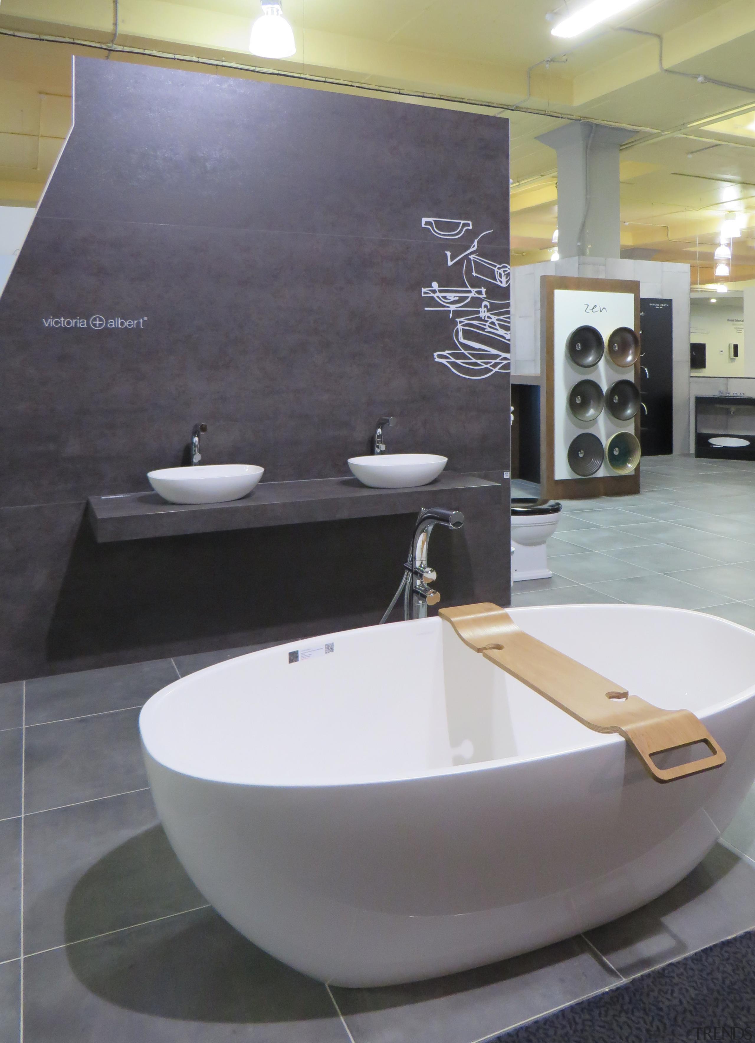 Freestanding tubs, vessel basins and bathroom accessories are architecture, bathroom, ceramic, floor, flooring, interior design, plumbing fixture, product design, sink, tap, tile, gray